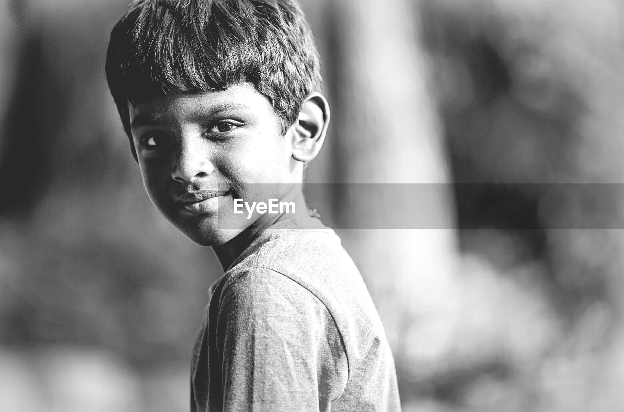 focus on foreground, human representation, close-up, art and craft, statue, art, creativity, sculpture, front view, headshot, portrait, day, selective focus, human face, outdoors, one person, looking at camera, childhood