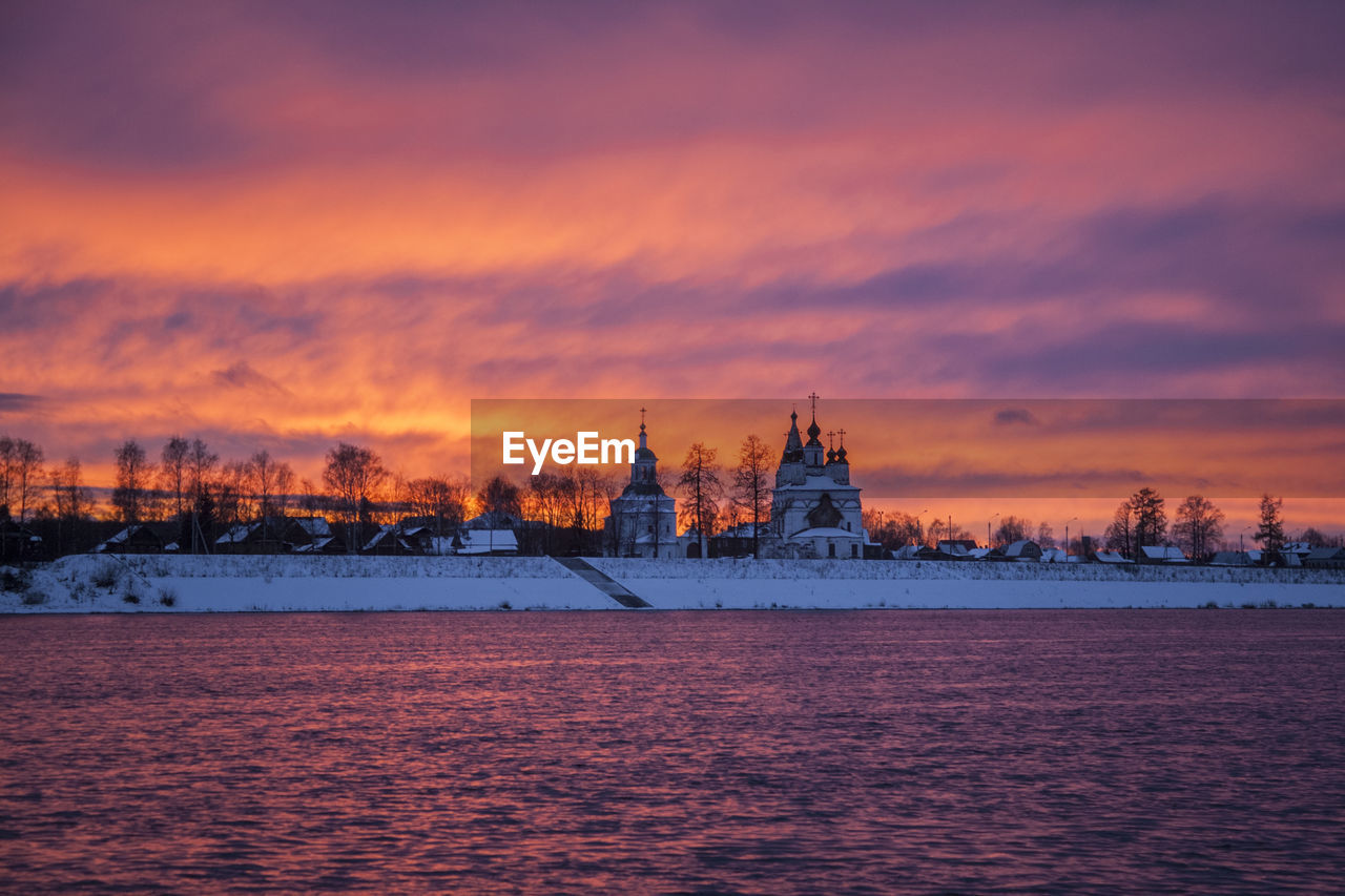 sky, sunset, cloud - sky, water, building exterior, architecture, waterfront, built structure, orange color, no people, nature, beauty in nature, place of worship, religion, scenics - nature, building, nautical vessel, belief, sea, outdoors
