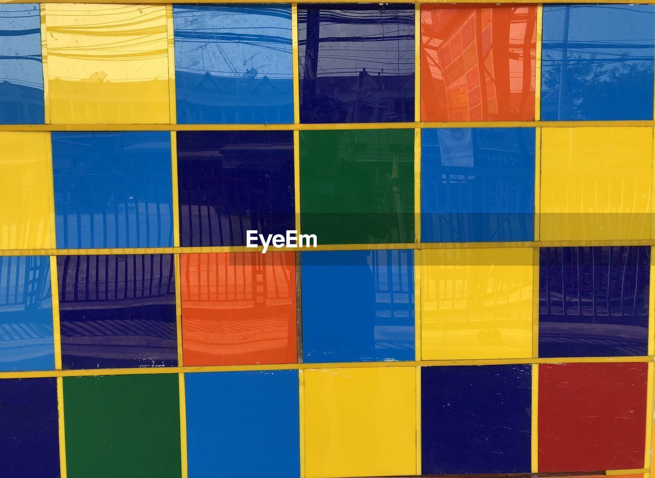 multi colored, full frame, backgrounds, pattern, no people, blue, paint, wall - building feature, side by side, art and craft, vibrant color, creativity, variation, yellow, close-up, choice, built structure, indoors, green color, purple