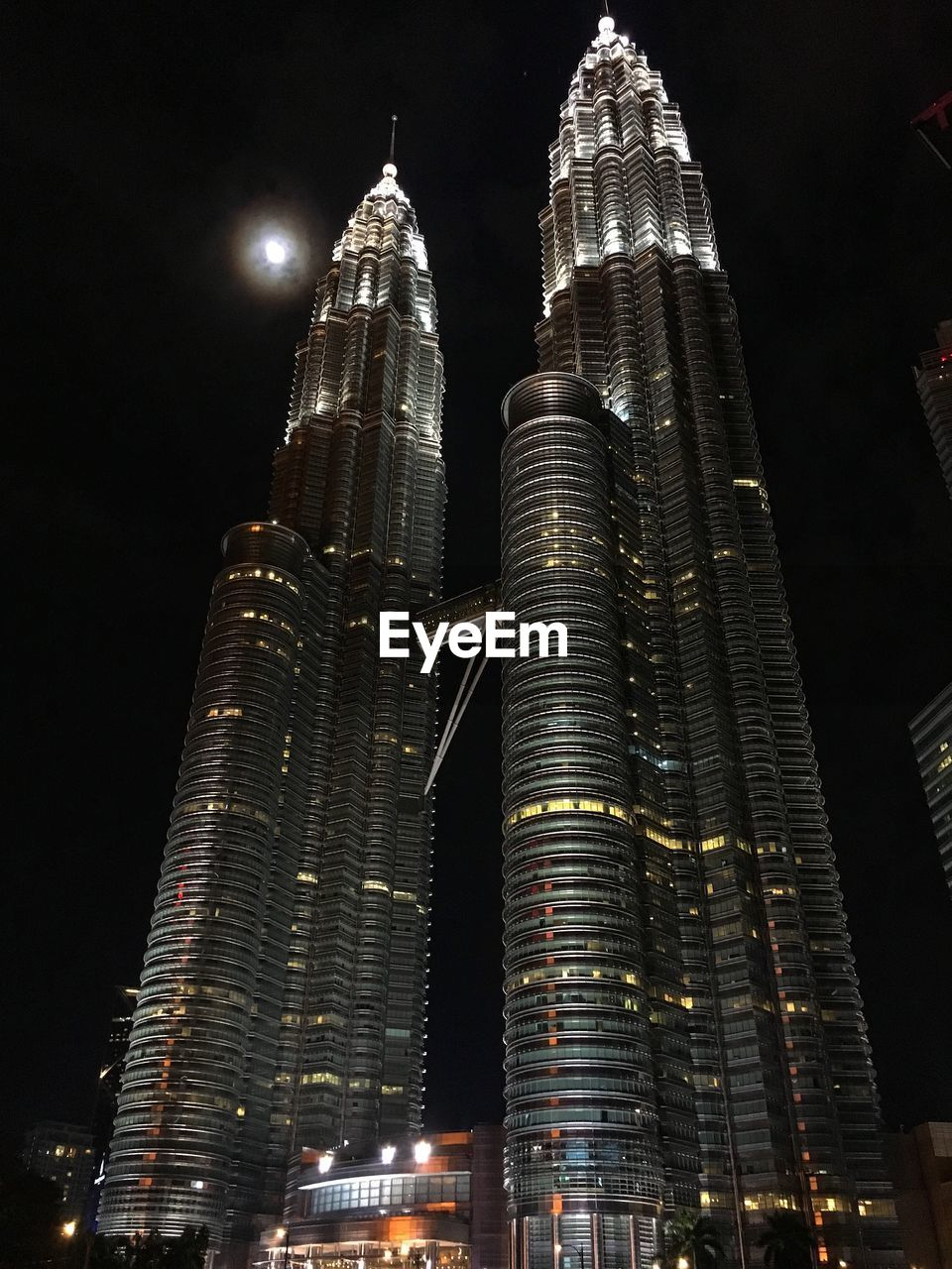 night, architecture, building exterior, built structure, illuminated, tall - high, building, city, low angle view, office building exterior, skyscraper, tower, no people, modern, travel destinations, sky, office, nature, outdoors, financial district, spire