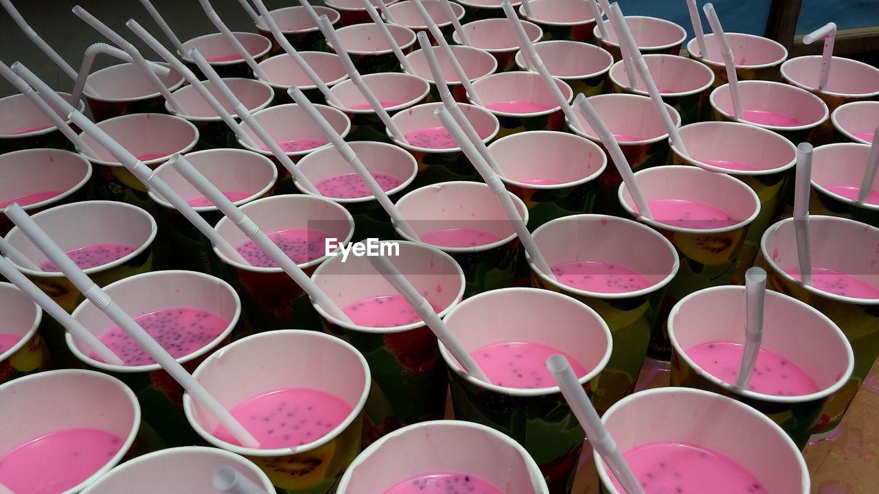 Full frame shot of drink on disposable glasses