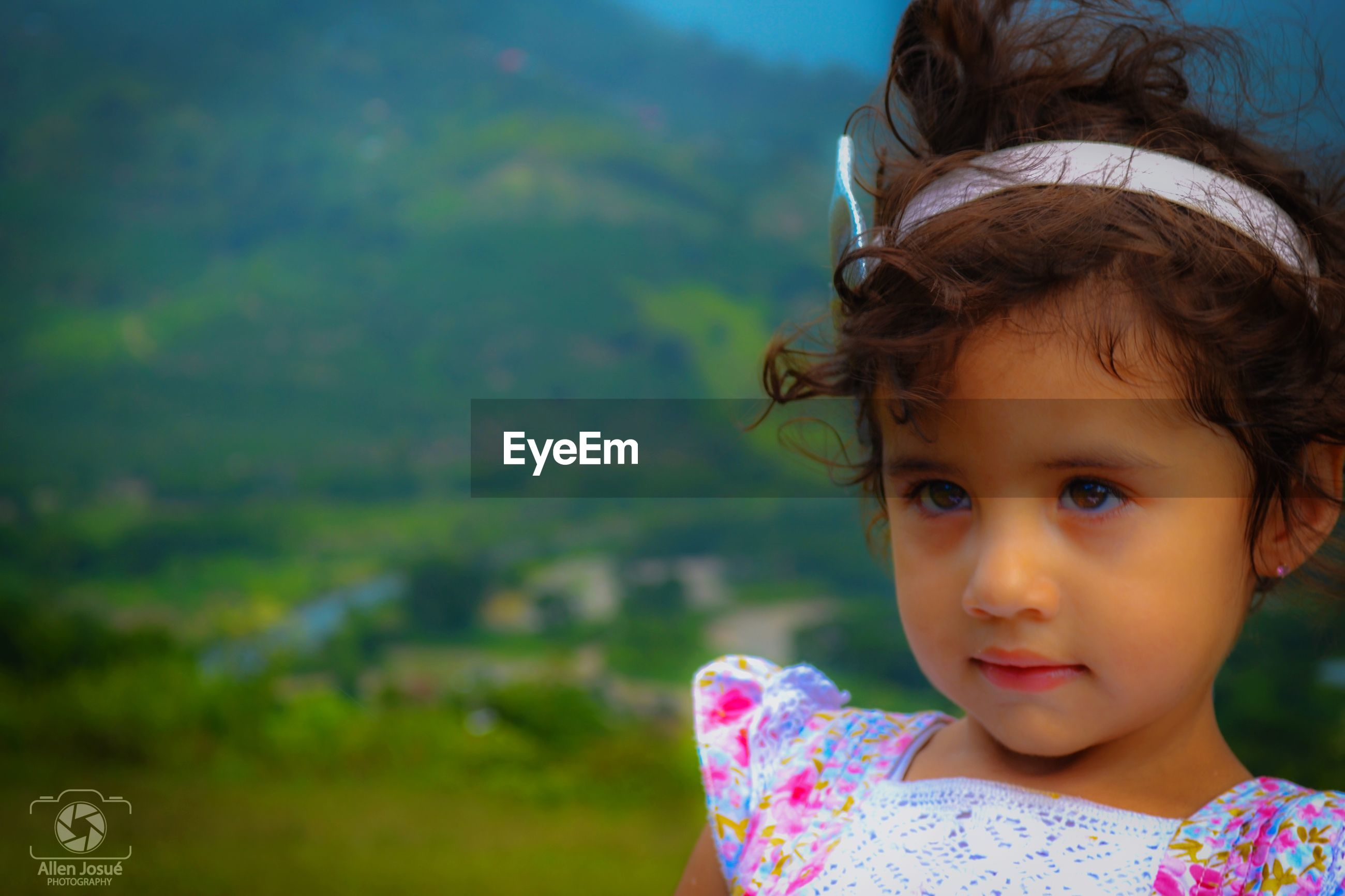 childhood, real people, focus on foreground, girls, innocence, one person, elementary age, outdoors, day, cute, lifestyles, headshot, leisure activity, looking at camera, close-up, portrait, nature, sky
