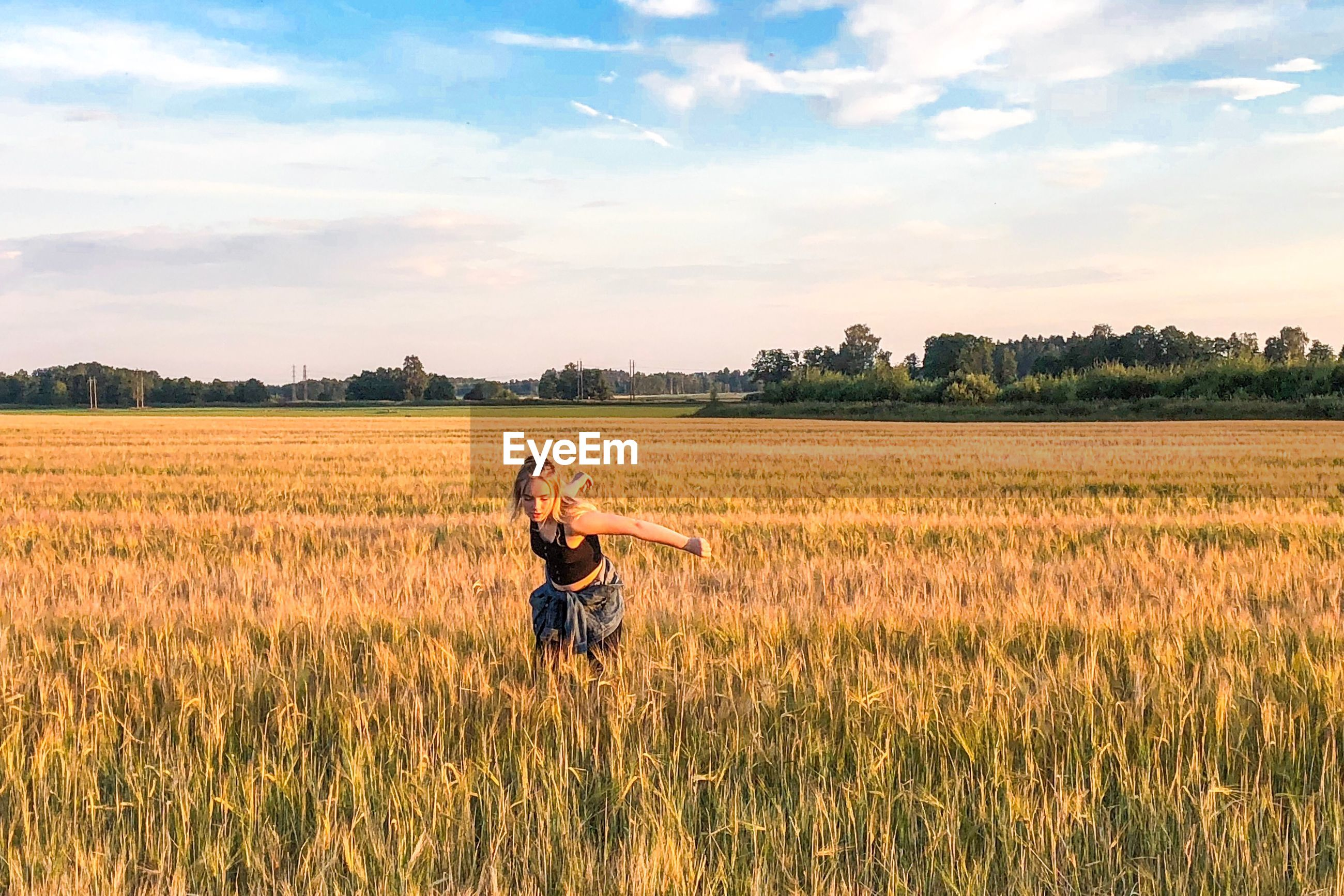 Woman standing on agricultural field
