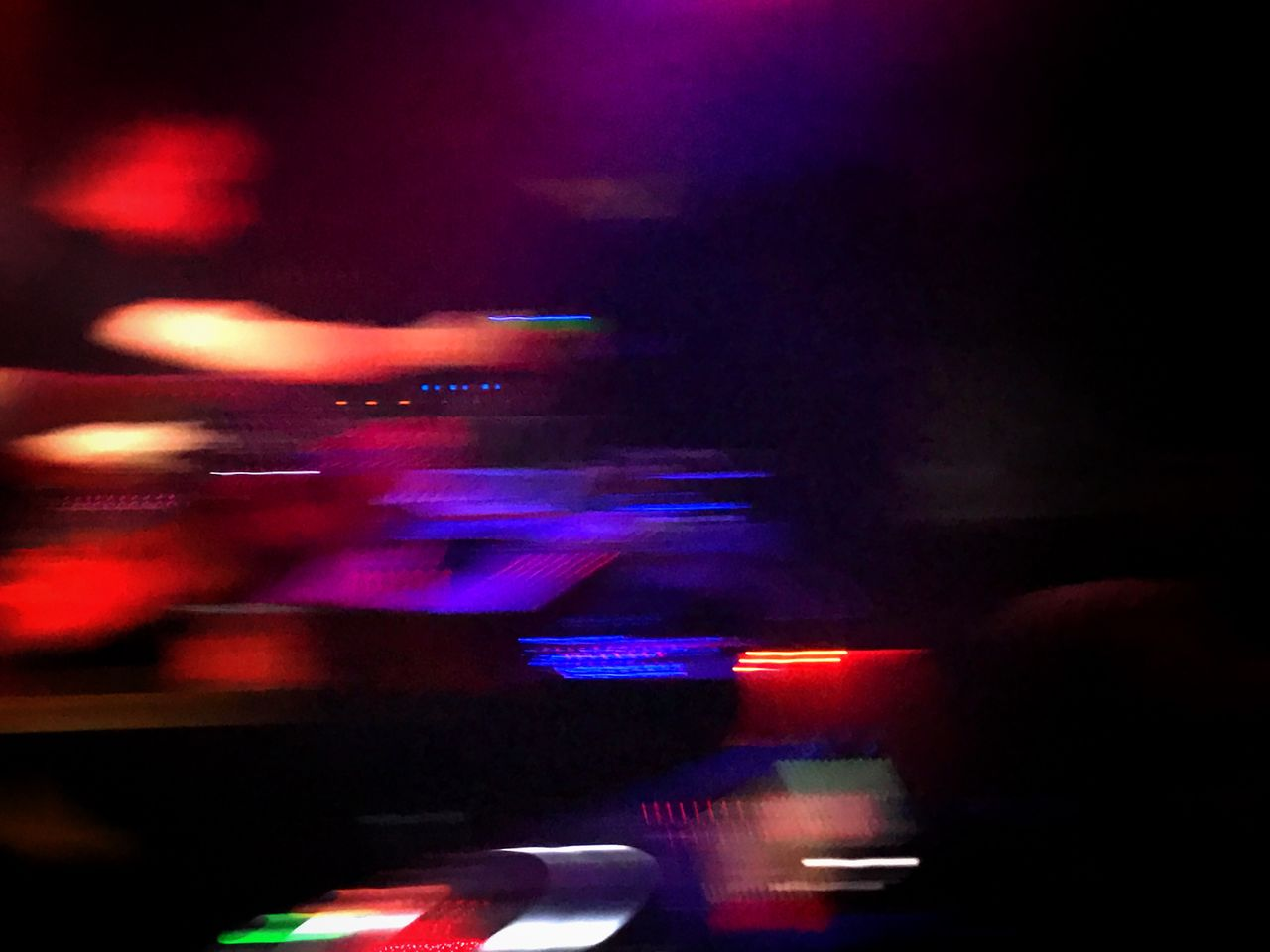 illuminated, night, blurred motion, arts culture and entertainment, burning, flame, motion, music, indoors, long exposure, nightlife, heat - temperature, celebration, real people, nightclub, technology, close-up, record player needle