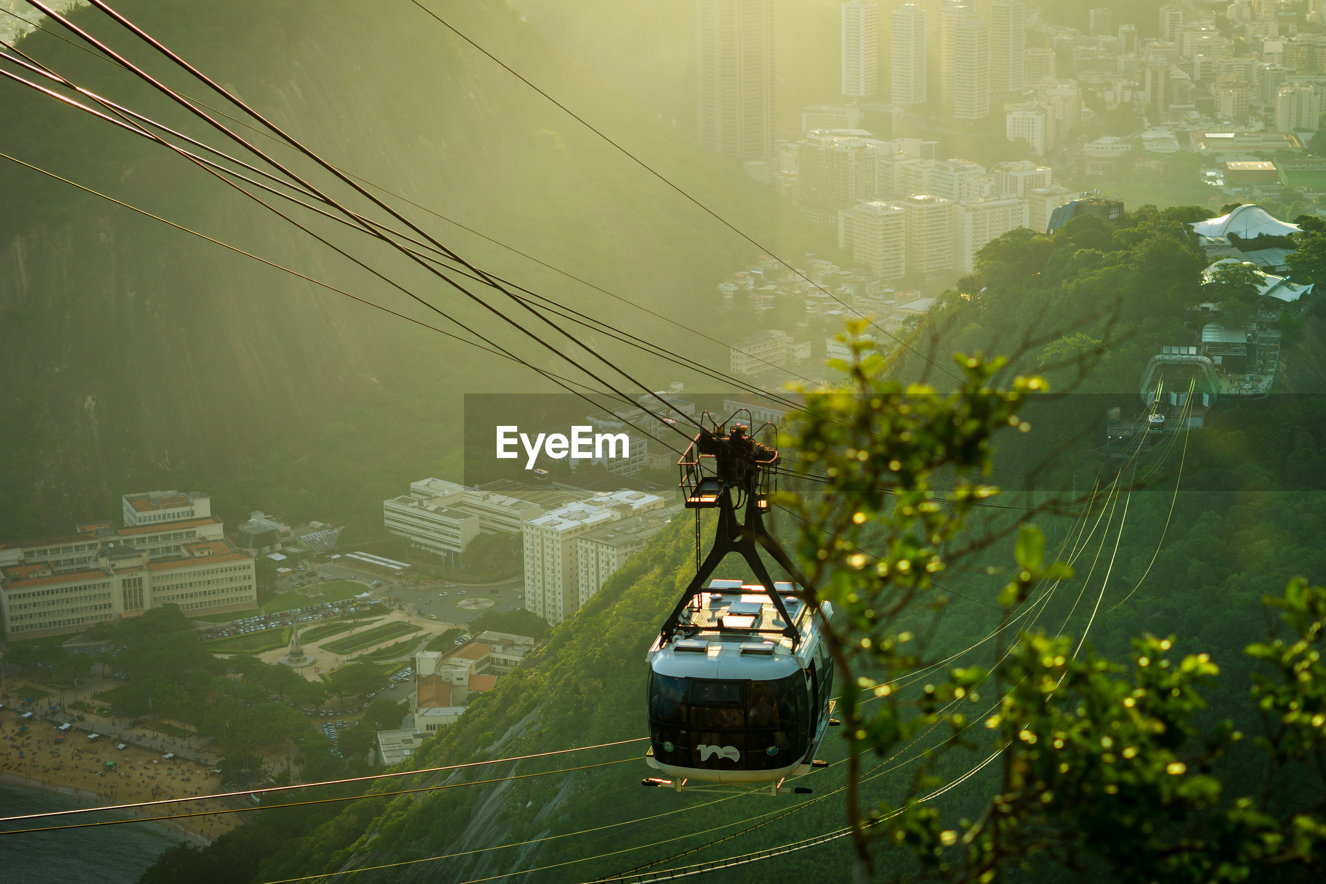 High angle view of overhead cable car over cityscape