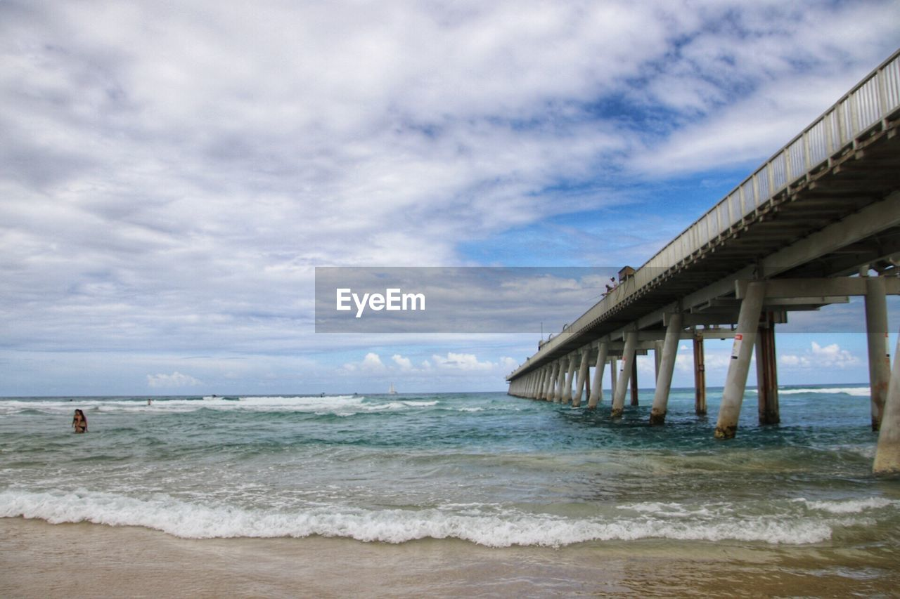 sea, beach, water, sky, cloud - sky, wave, horizon over water, nature, sand, architecture, built structure, day, outdoors, beauty in nature, scenics, no people