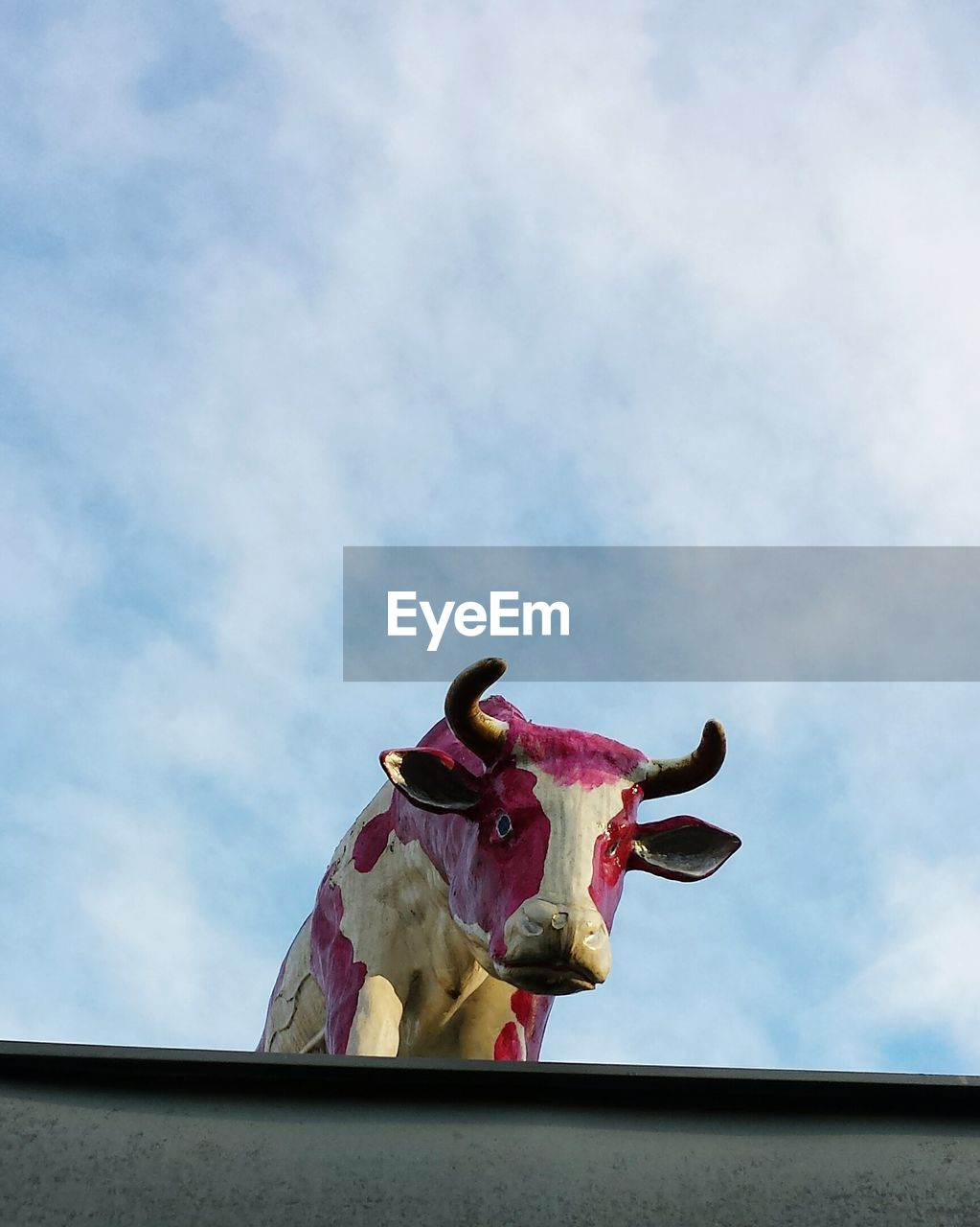Low Angle View Of Cow Sculpture Against Sky