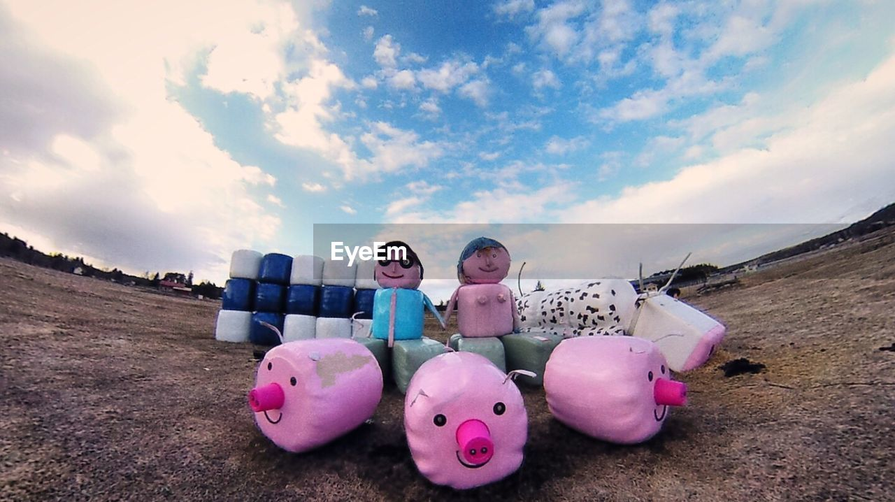 sky, cloud - sky, piggy bank, pink color, large group of objects, outdoors, day, no people, childhood