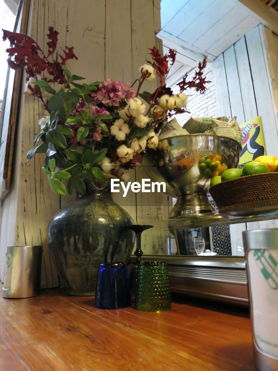 flower, bottle, vase, table, indoors, no people, freshness, food, fragility, day, close-up