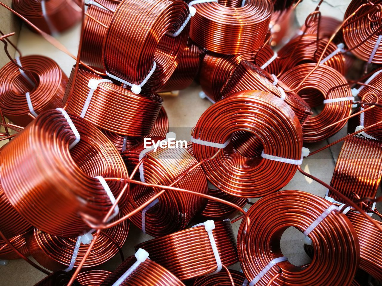 High Angle View Of Rolled Up Metallic Wires