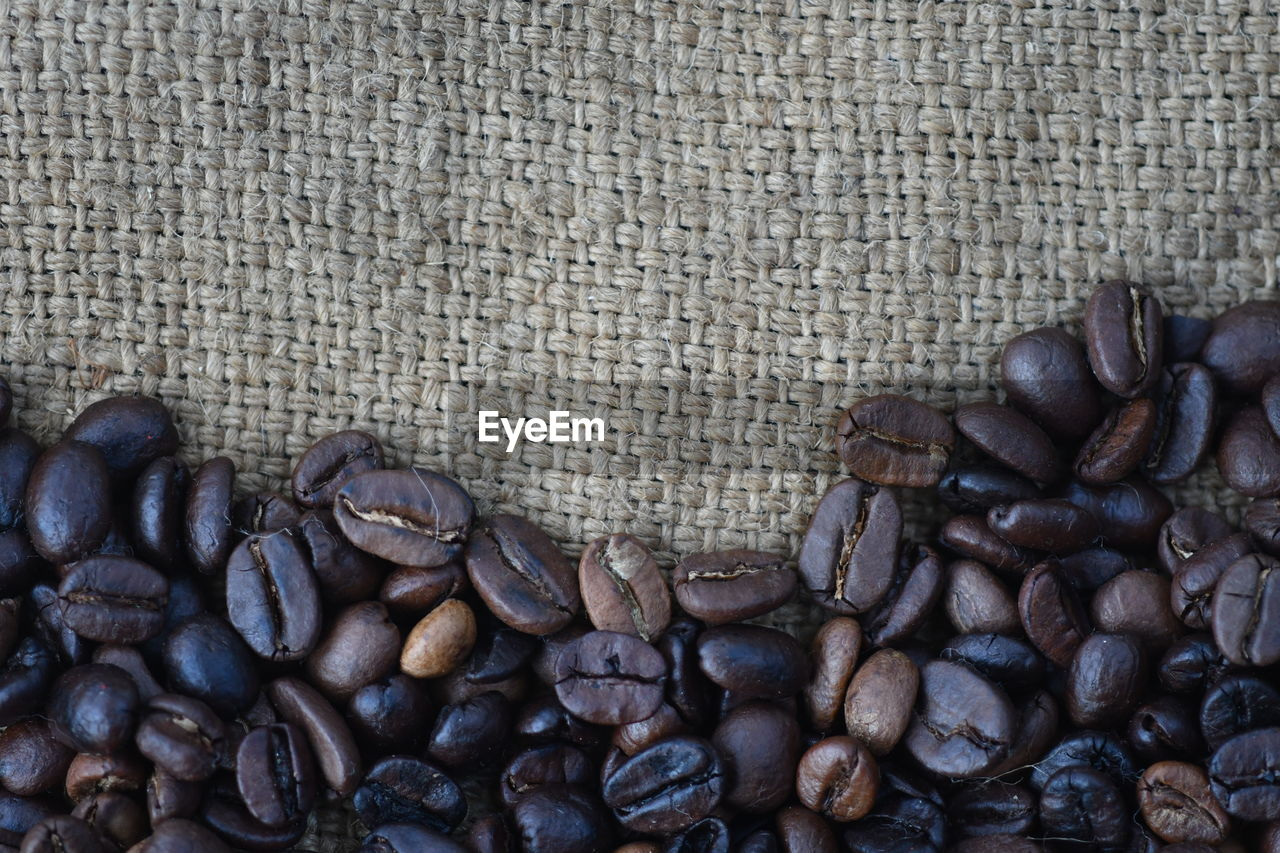 High Angle View Of Roasted Coffee Beans On Jute