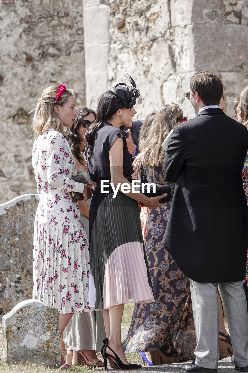 group of people, women, real people, togetherness, emotion, standing, lifestyles, people, adult, friendship, architecture, city, day, clothing, men, young adult, females, leisure activity, fashion, outdoors, hairstyle, arm around