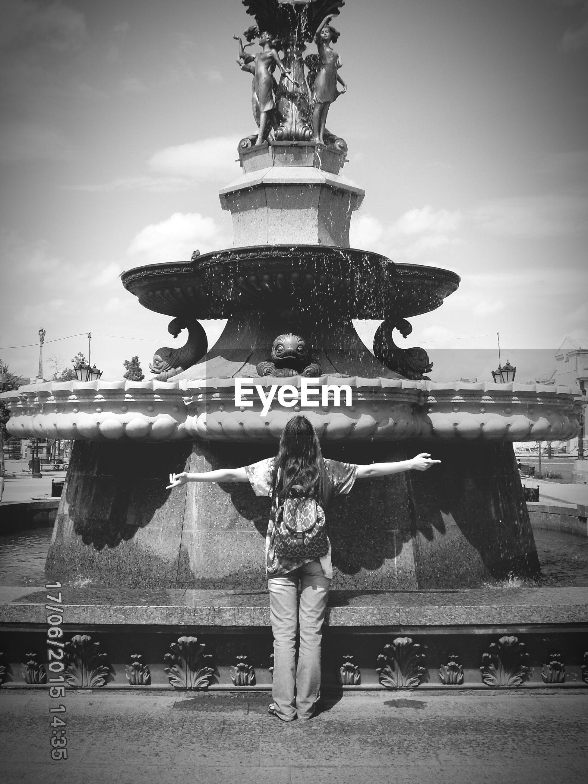 statue, sculpture, human representation, art and craft, art, sky, creativity, fountain, water, built structure, architecture, animal representation, cloud - sky, building exterior, travel destinations, travel, outdoors, famous place