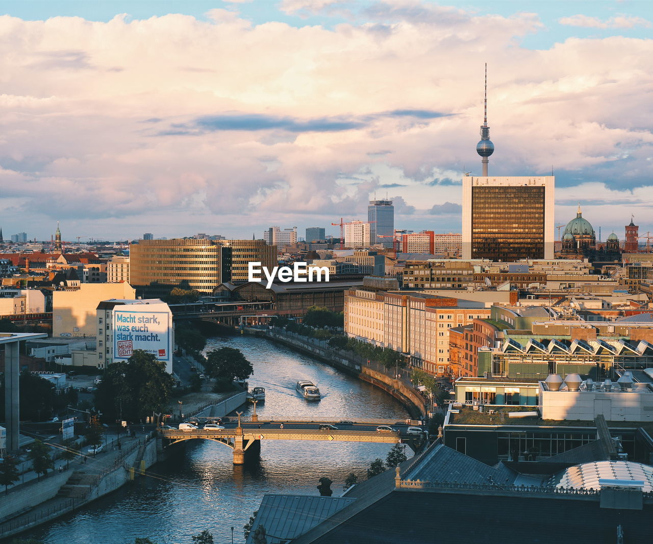 High angle view of spree river by fernsehturm amidst buildings in city