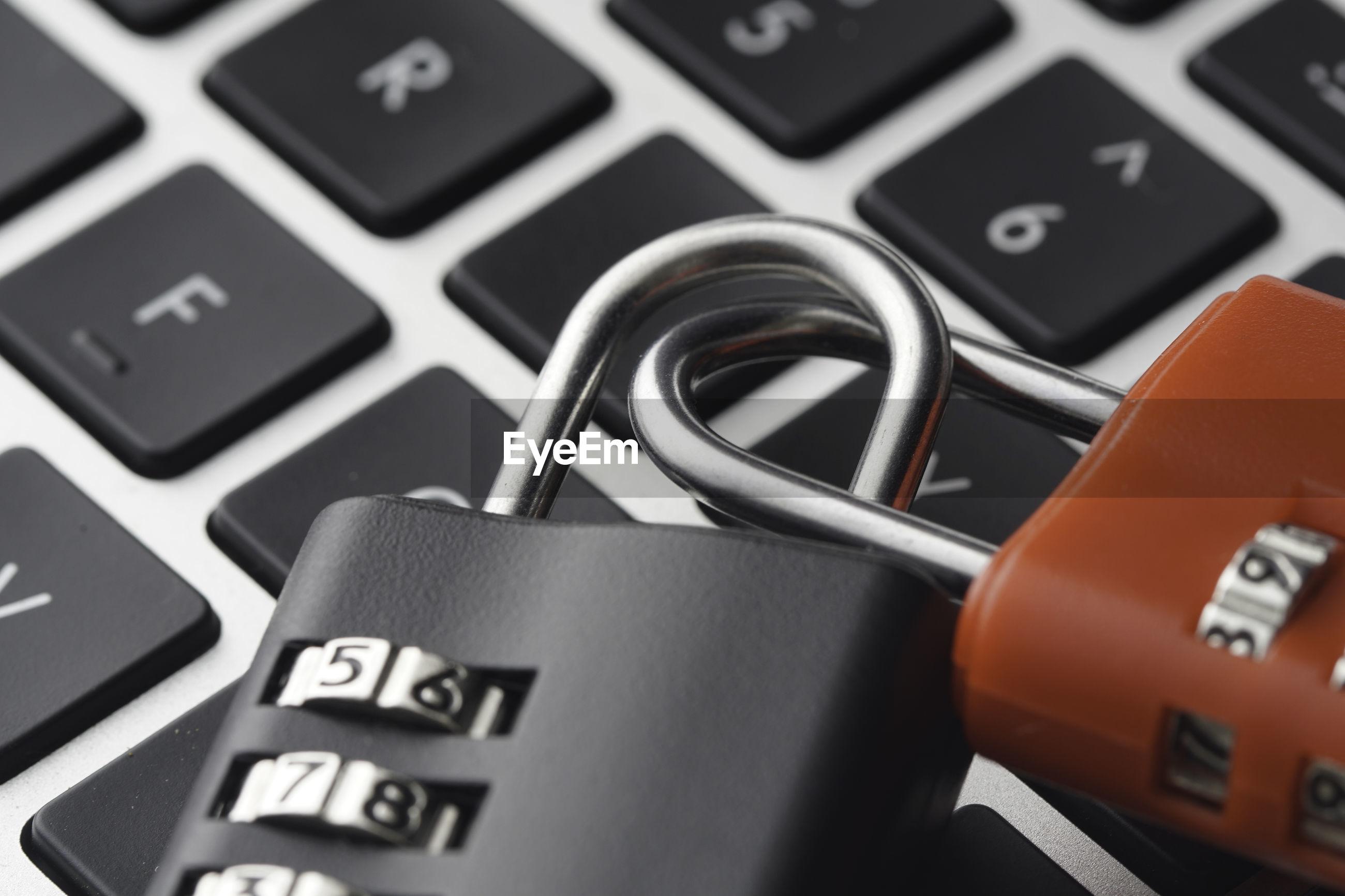 Close-up of padlocks on computer keyboard