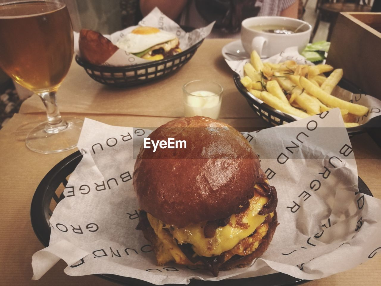 food and drink, ready-to-eat, food, fast food, table, freshness, drink, still life, burger, text, refreshment, unhealthy eating, indoors, restaurant, glass, french fries, close-up, no people, potato, plate, hamburger, temptation, snack