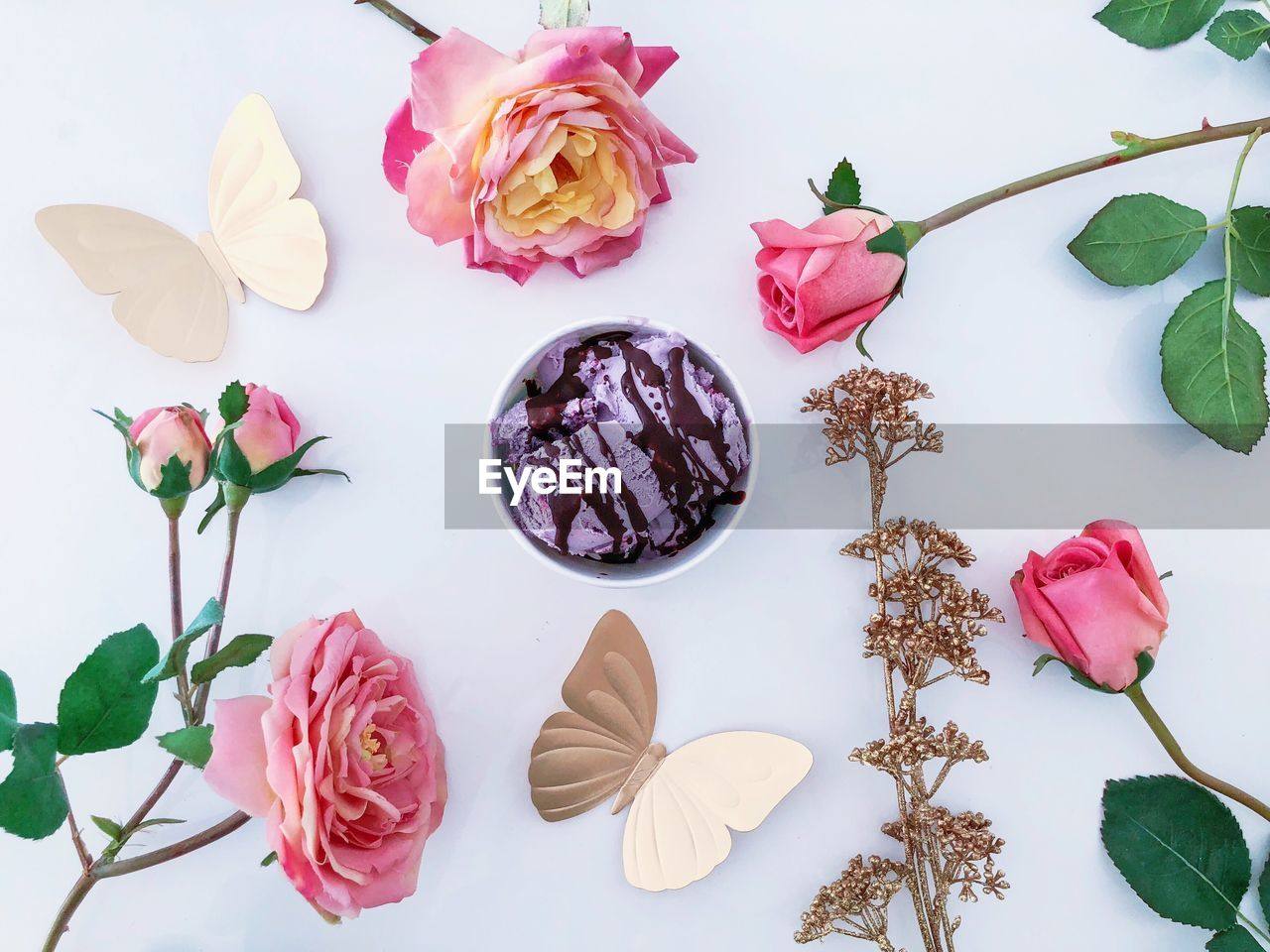 plant, beauty in nature, flower, freshness, flowering plant, vulnerability, rose, fragility, pink color, petal, nature, rose - flower, indoors, no people, close-up, table, still life, leaf, plant part, high angle view, flower head