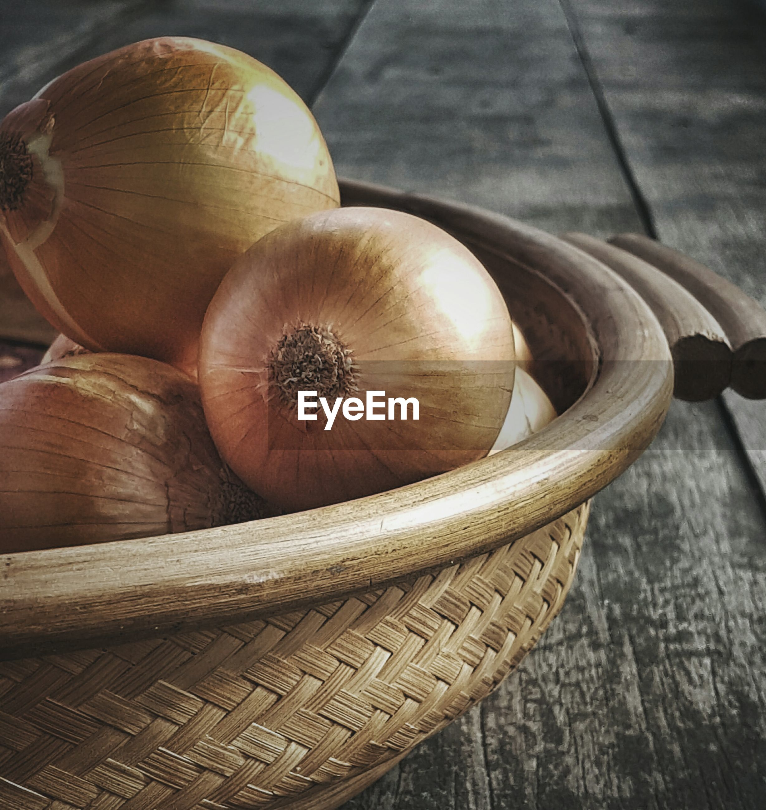 Close-up of onions in basket on table