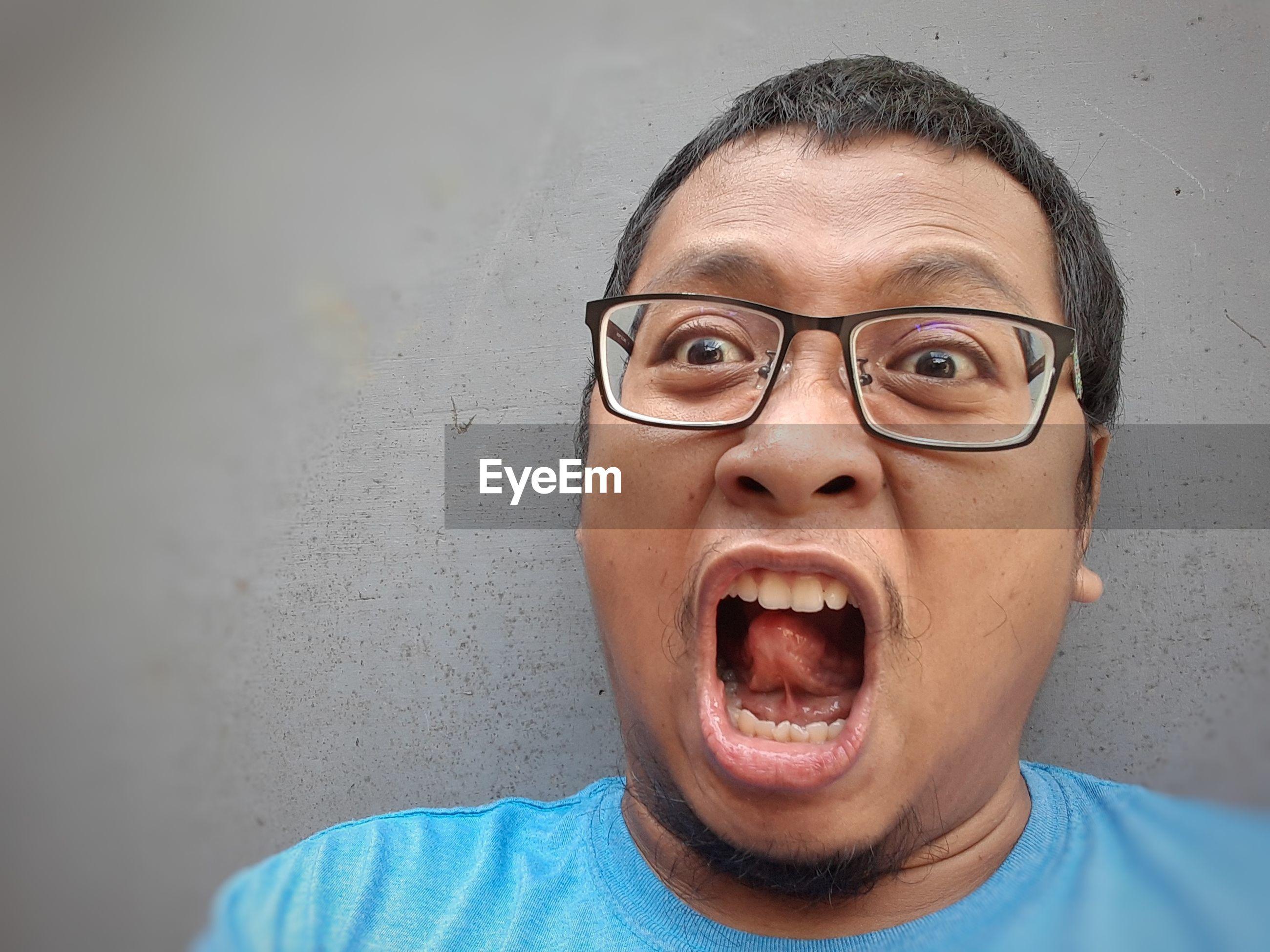 Portrait of man screaming