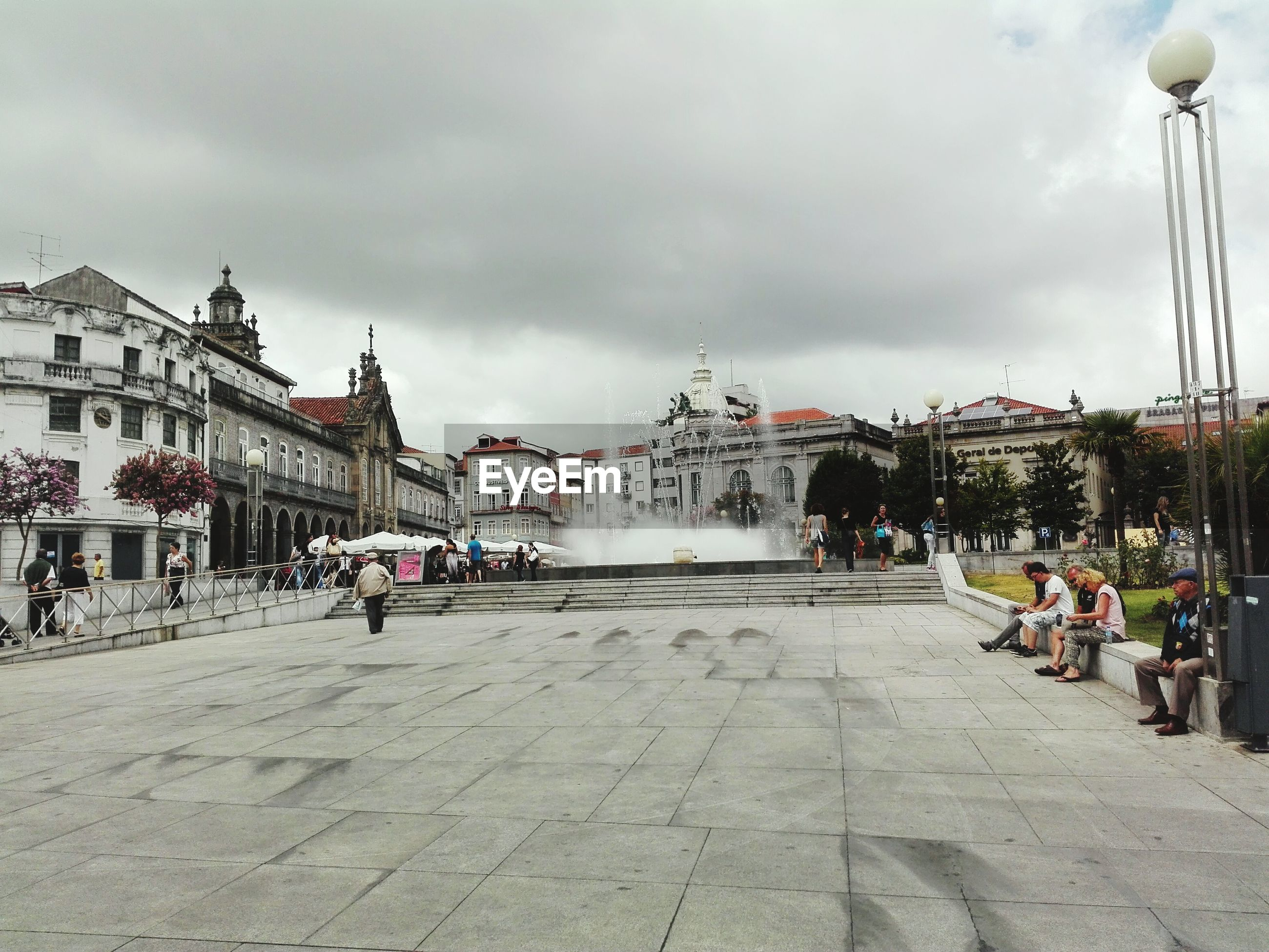 People at braga centro with fountain against sky