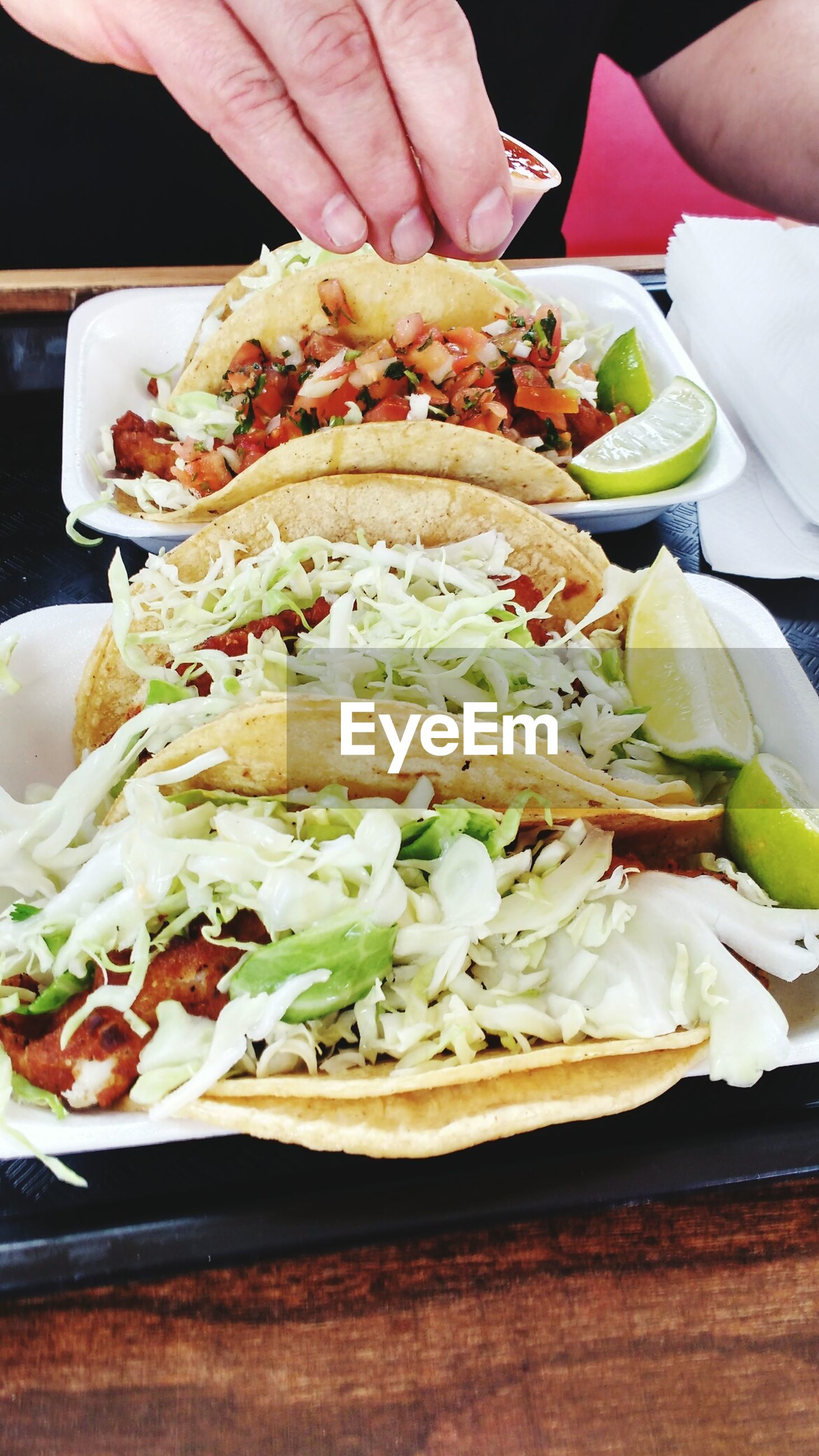 High angle view of tacos served in plate at restaurant