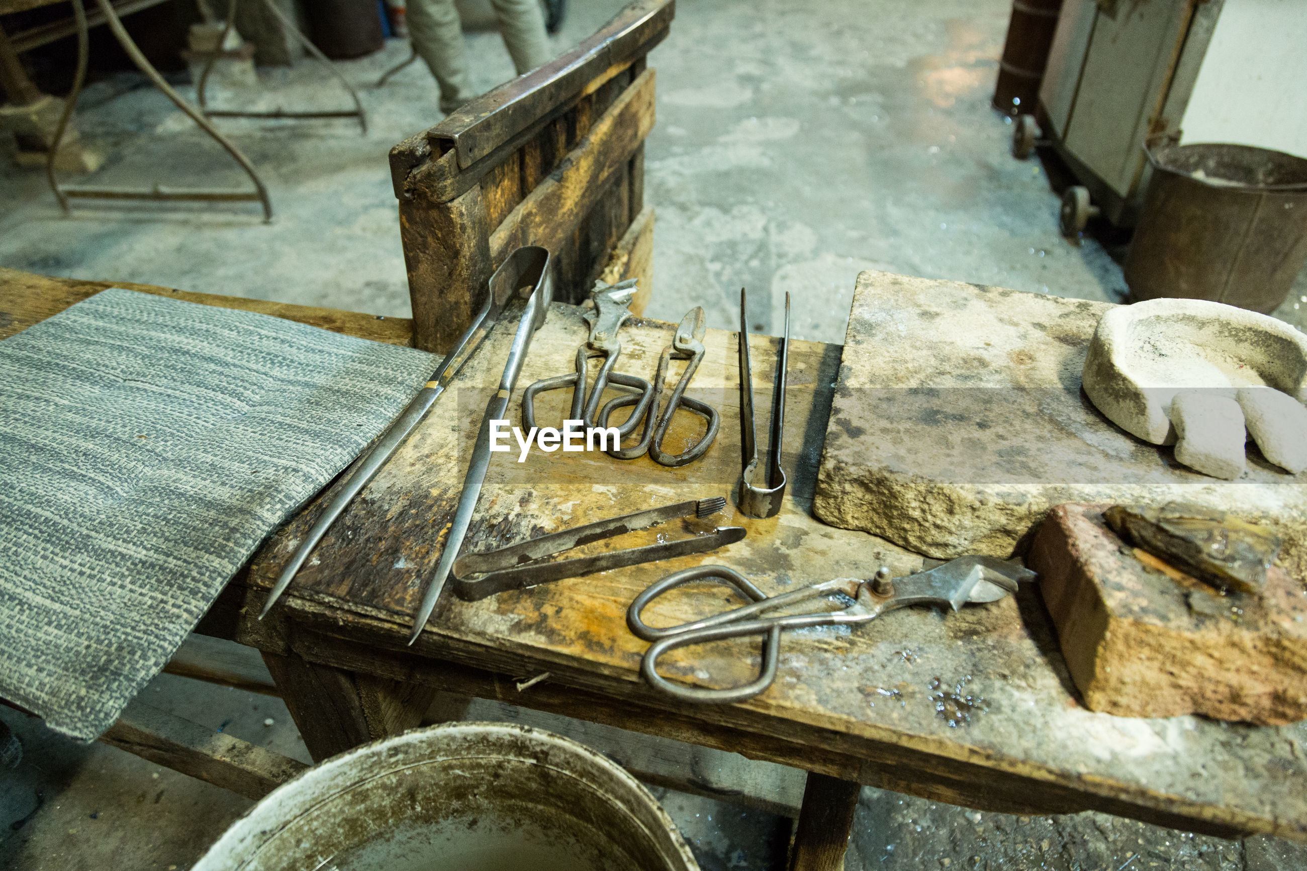 High angle view of work tools on wooden table at factory