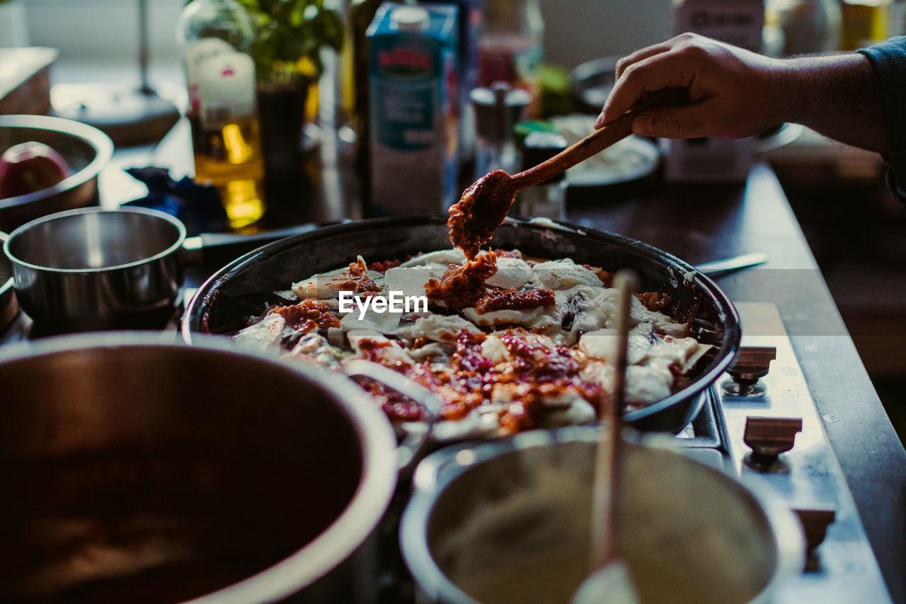 Cropped Image Of Hand Preparing Food