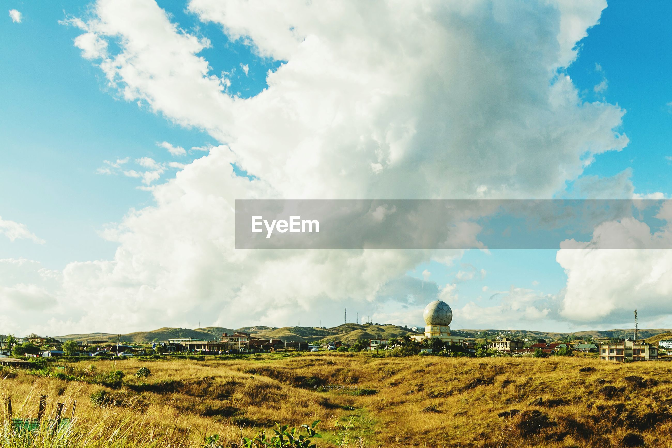 PANORAMIC VIEW OF FARM AGAINST SKY
