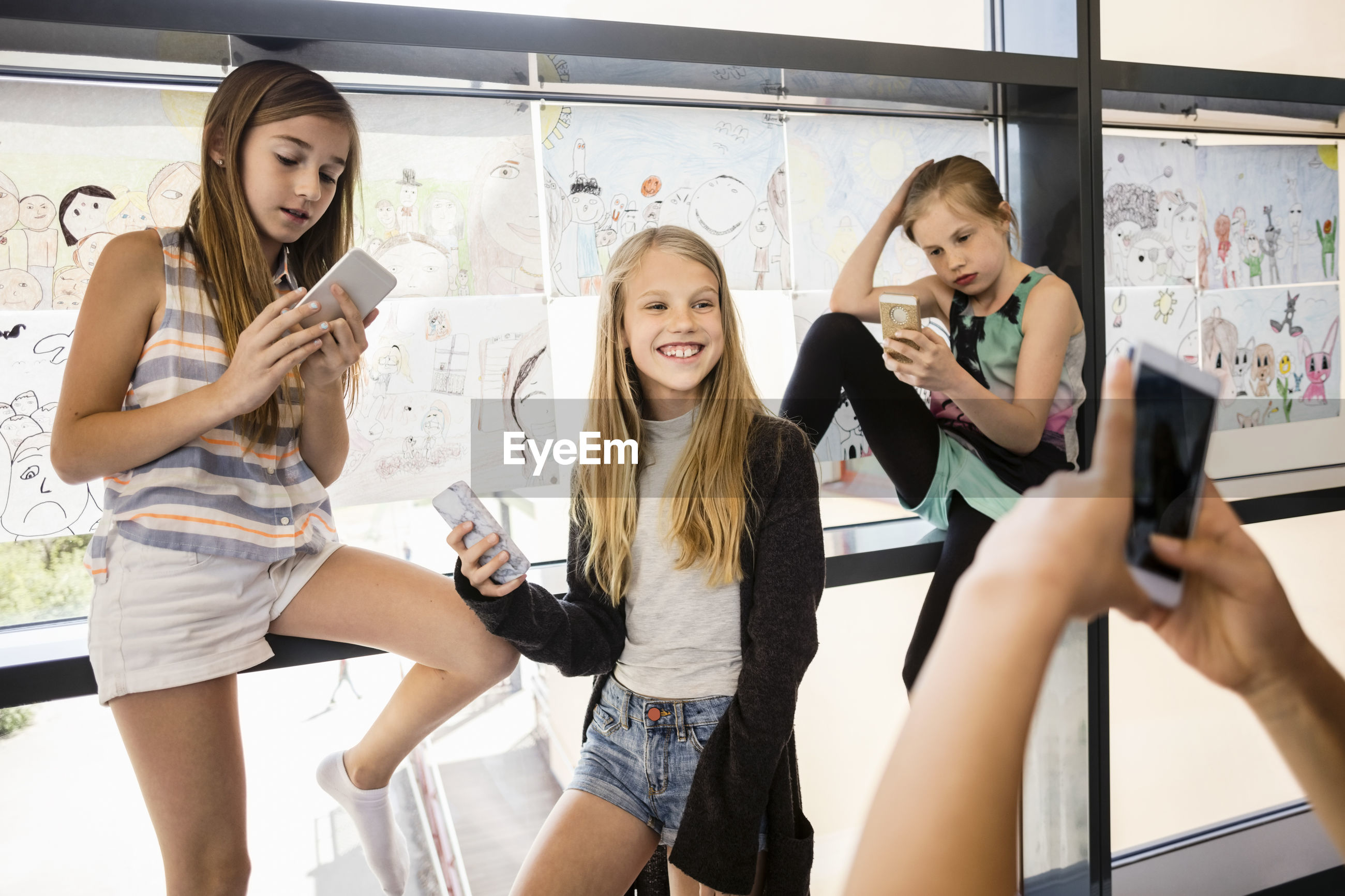FRIENDS STANDING ON A PHONE