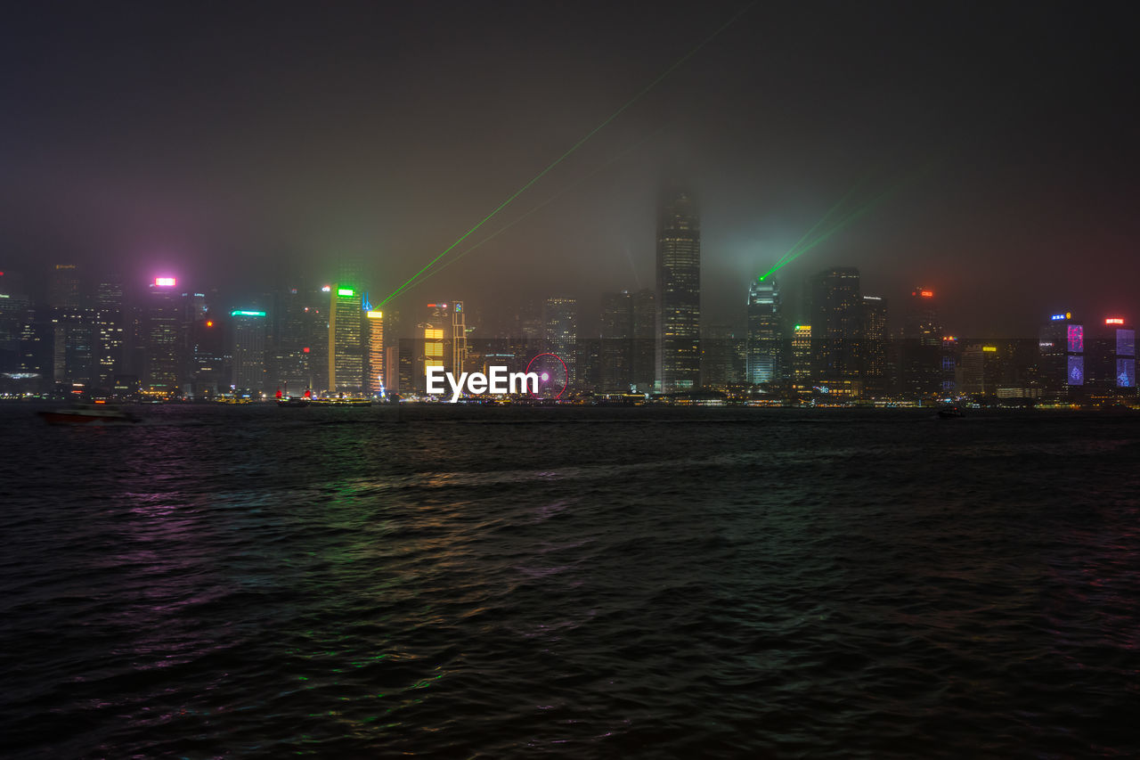 built structure, architecture, building exterior, city, illuminated, waterfront, night, building, water, skyscraper, office building exterior, sky, urban skyline, tall - high, no people, landscape, nature, tower, cityscape, modern, financial district