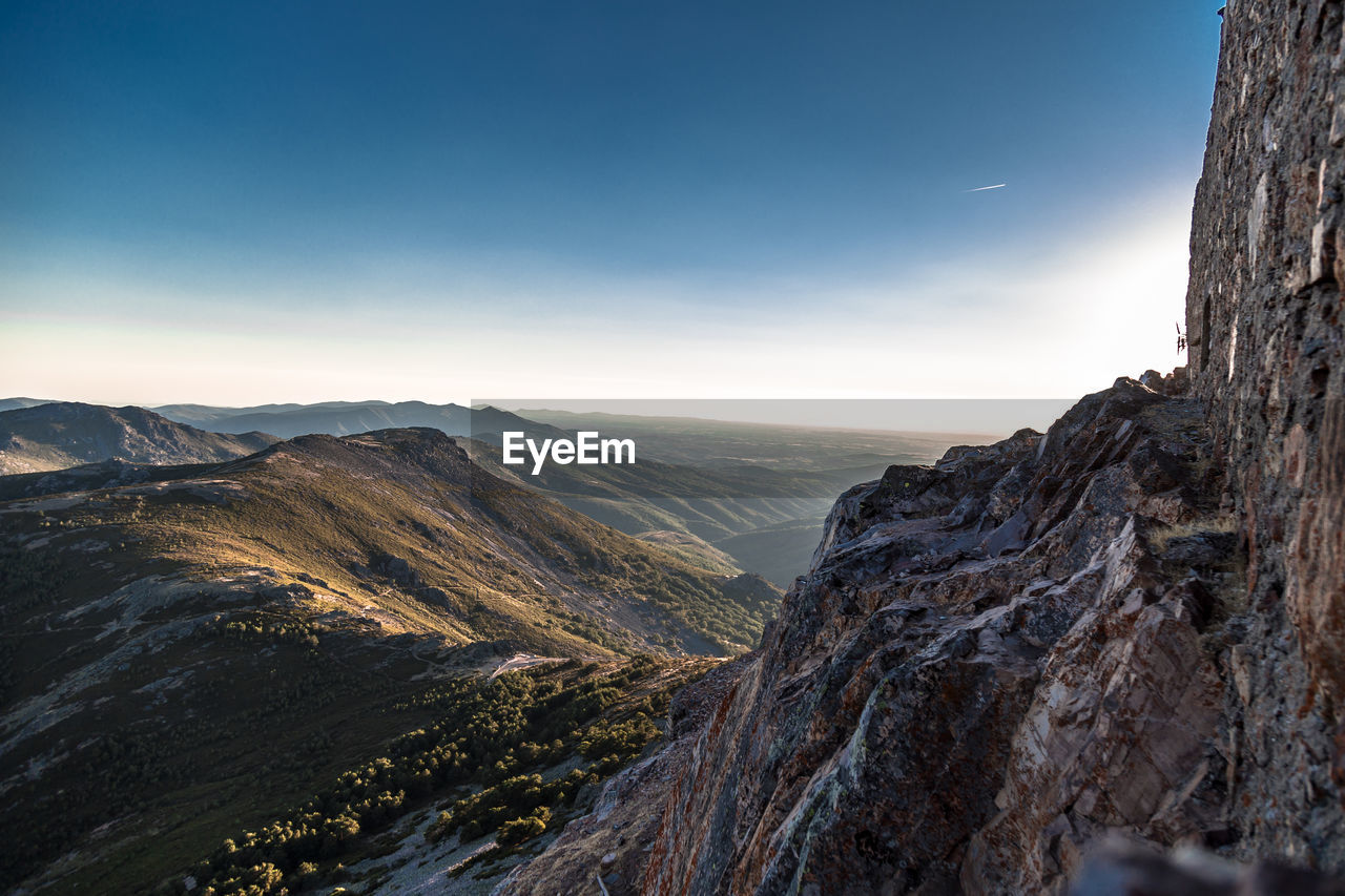 mountain, sky, scenics - nature, beauty in nature, tranquil scene, mountain range, nature, tranquility, environment, idyllic, non-urban scene, no people, landscape, outdoors, day, rock, valley, remote, mountain peak, clear sky, formation, high