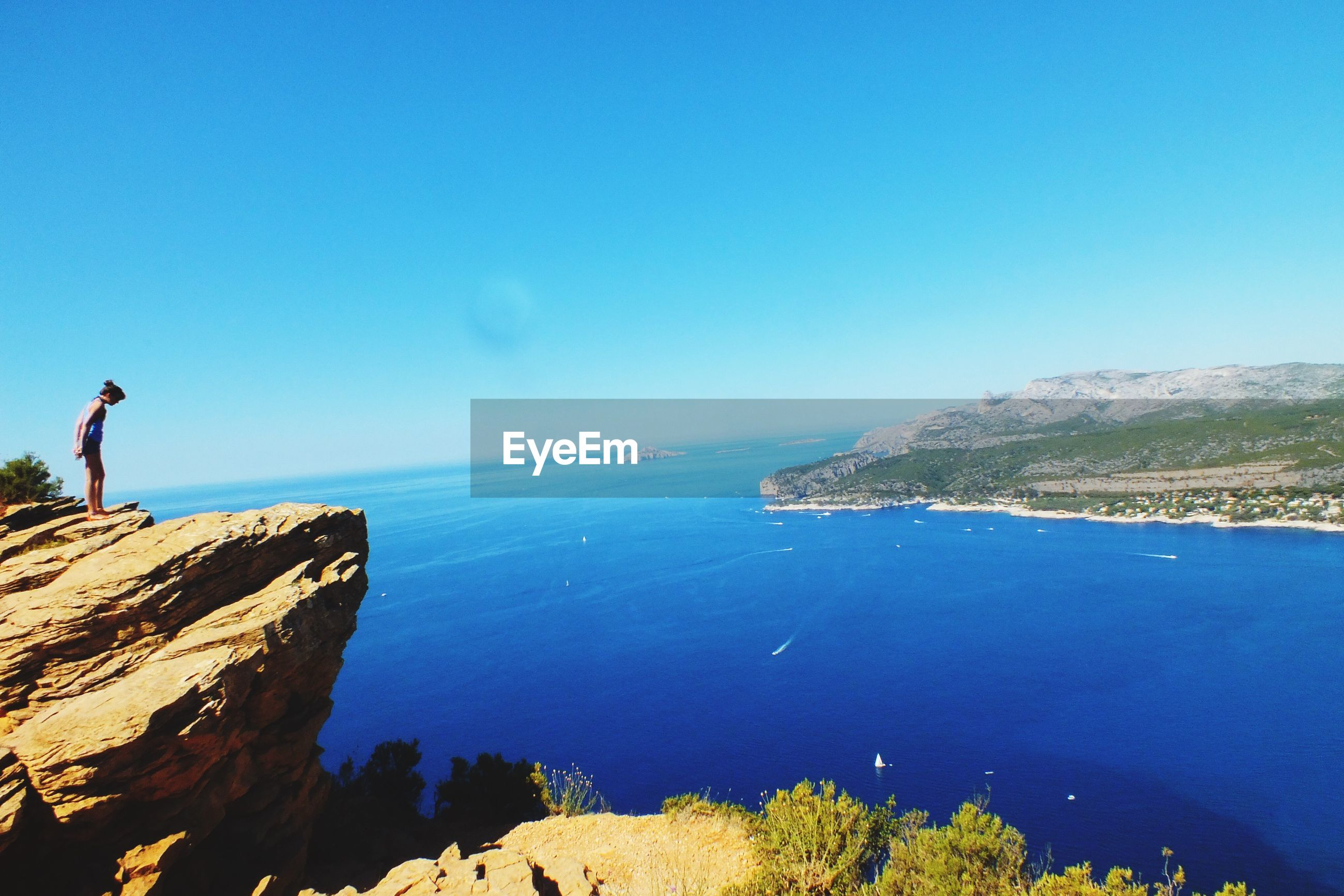 water, sea, blue, horizon over water, tranquil scene, scenics, tranquility, clear sky, beauty in nature, nature, remote, outdoors, calm, day, sky, majestic, solitude, vacations, cliff, coastline, shore