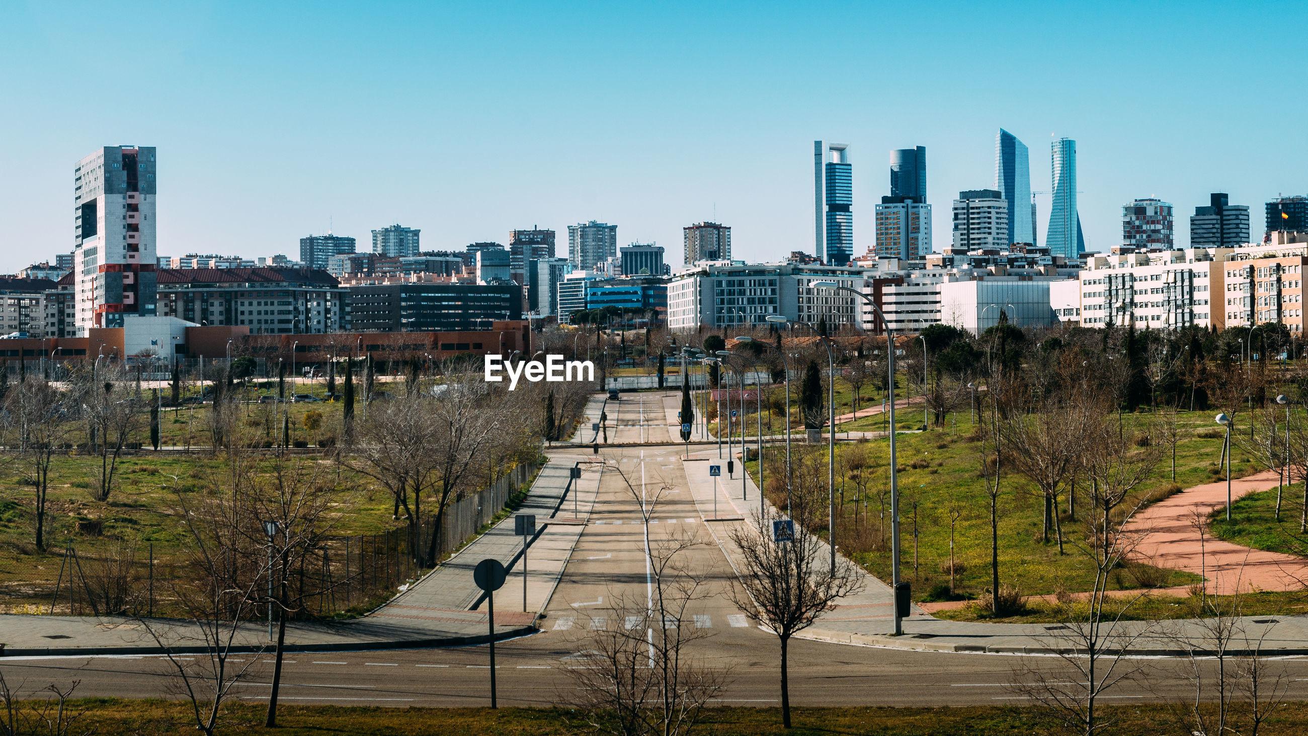 VIEW OF MODERN BUILDINGS AGAINST SKY