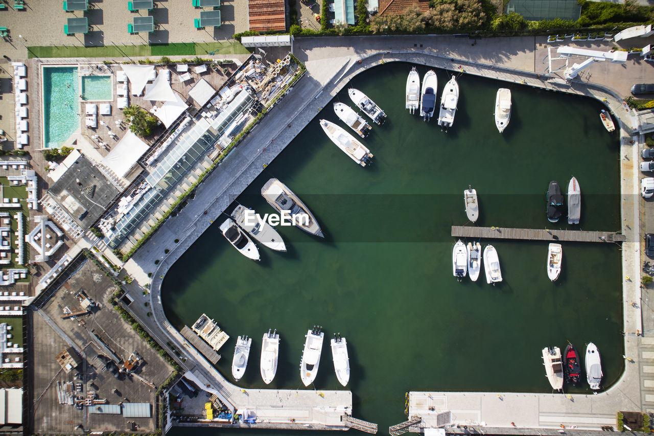 architecture, built structure, no people, building exterior, day, water, green color, transportation, mode of transportation, city, outdoors, high angle view, building, nautical vessel, connection, communication, travel, nature, car, canal
