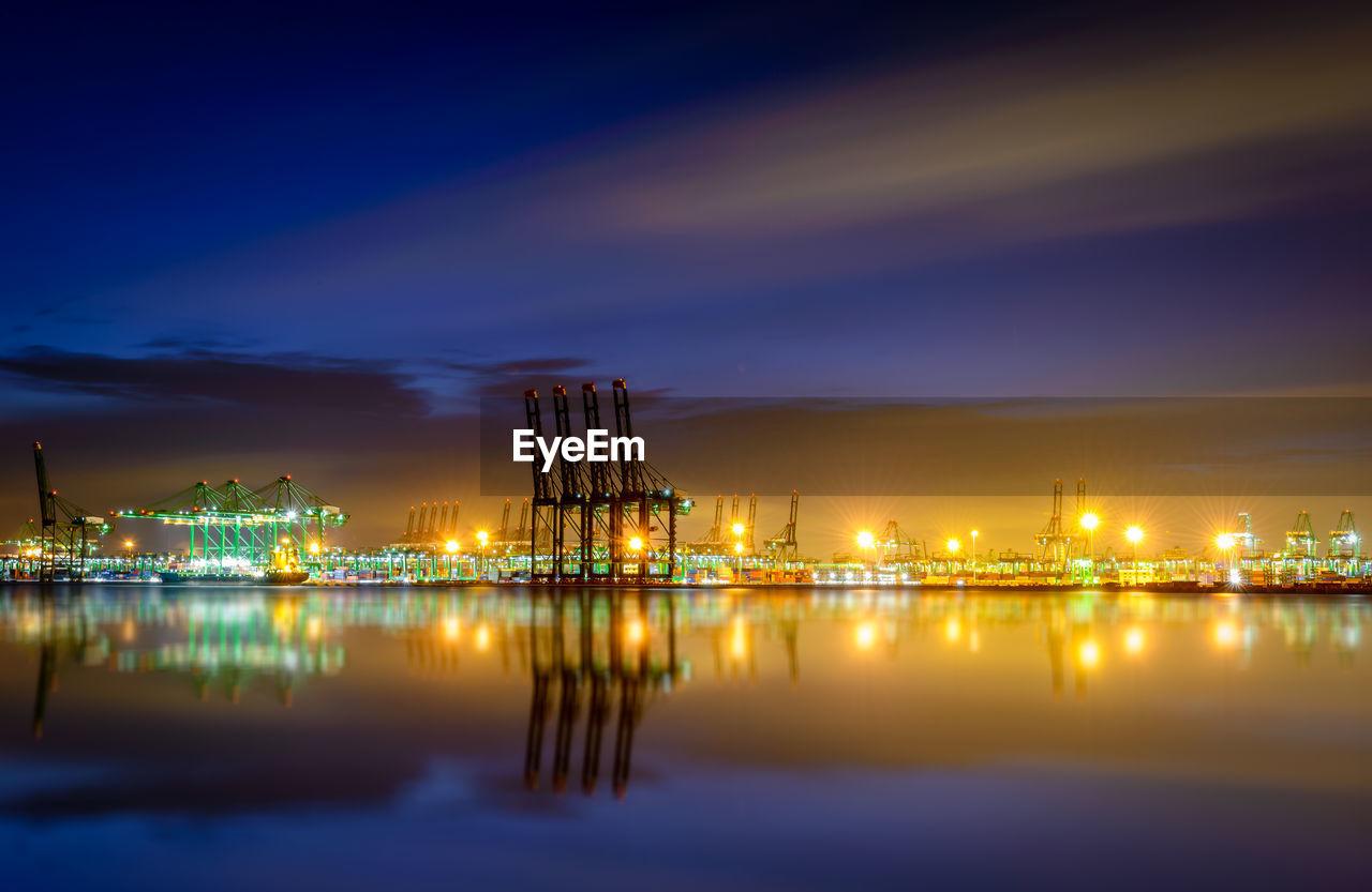 Illuminated Harbor At Night