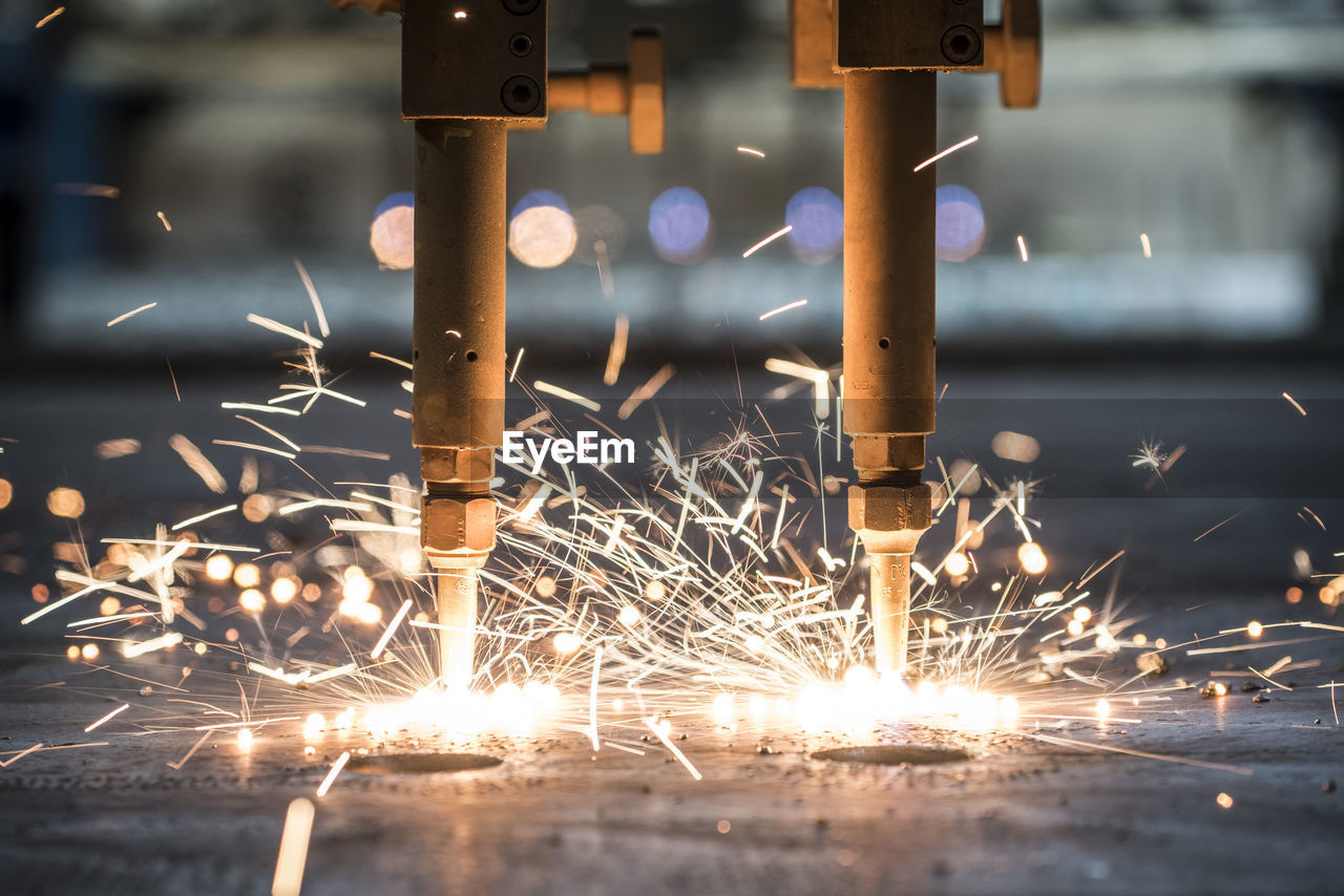 Close-Up Of Machinery Cutting Steel