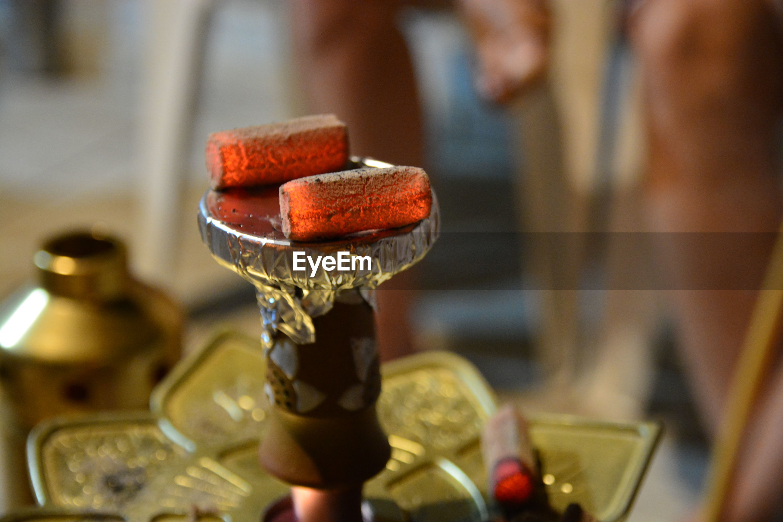 Close-up of hookah equipment on table
