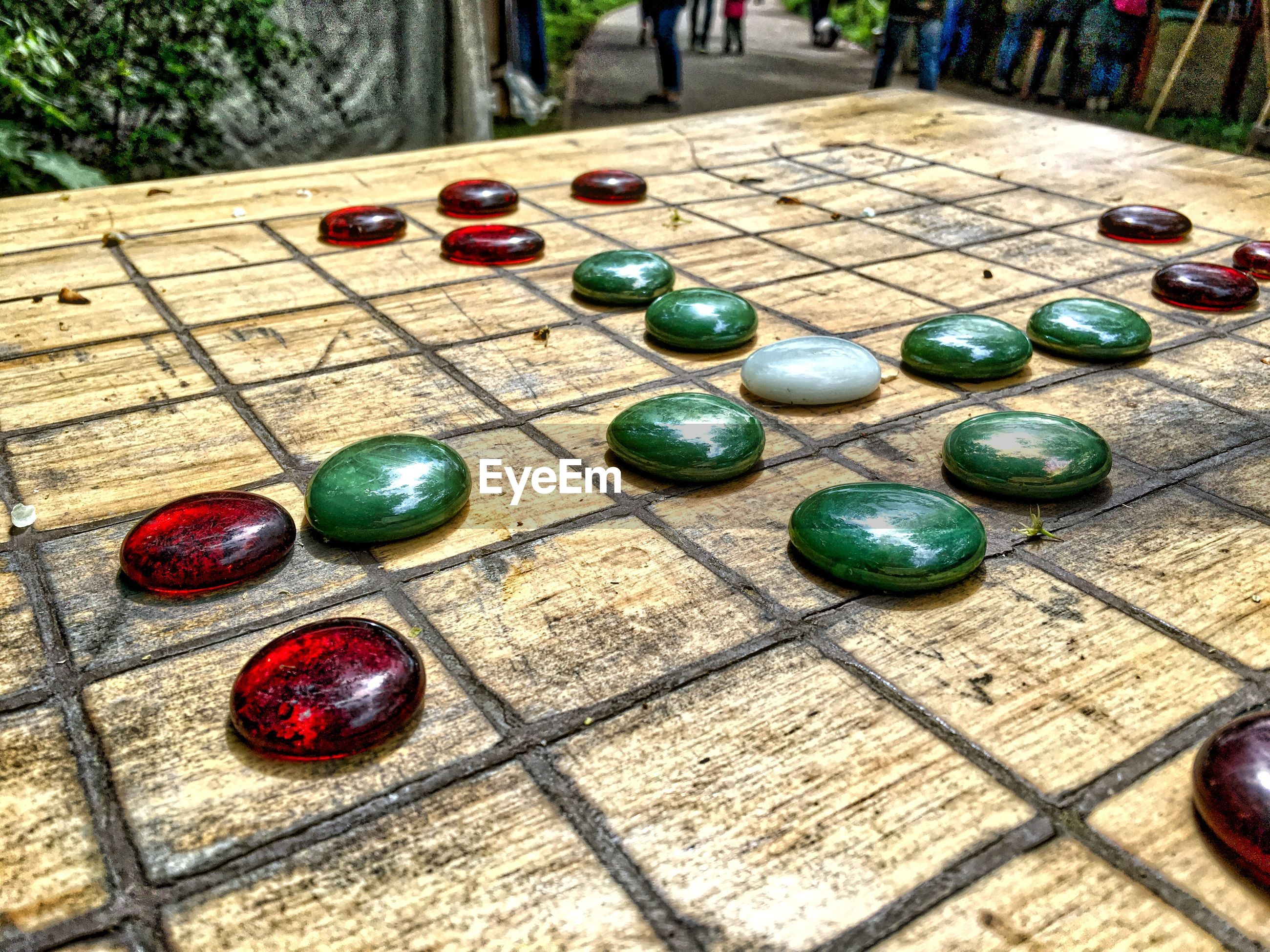 day, wood - material, no people, outdoors, marbles, leisure games, close-up, chess piece