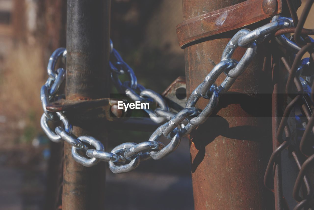 chain, metal, no people, strength, focus on foreground, lock, protection, close-up, safety, security, day, rusty, connection, outdoors, attached, tied up, hanging, old, mode of transportation, padlock