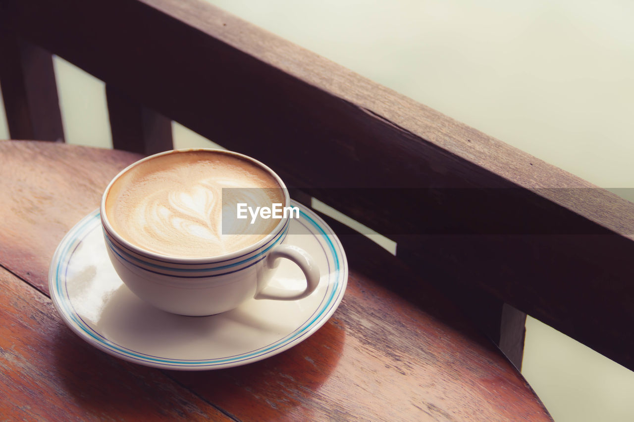 coffee, coffee - drink, coffee cup, cup, mug, food and drink, drink, refreshment, table, still life, frothy drink, saucer, crockery, froth art, hot drink, cappuccino, wood - material, freshness, no people, high angle view, latte, non-alcoholic beverage, froth