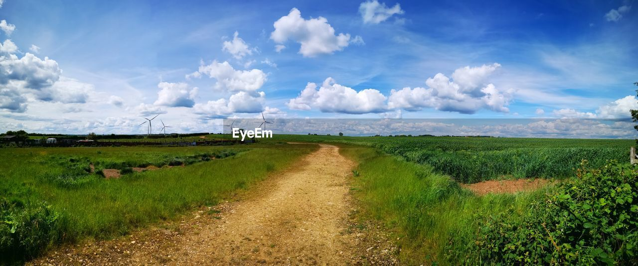 landscape, cloud - sky, sky, environment, field, land, tranquil scene, scenics - nature, tranquility, plant, beauty in nature, rural scene, nature, direction, grass, agriculture, day, road, horizon, dirt road, no people, outdoors, trail
