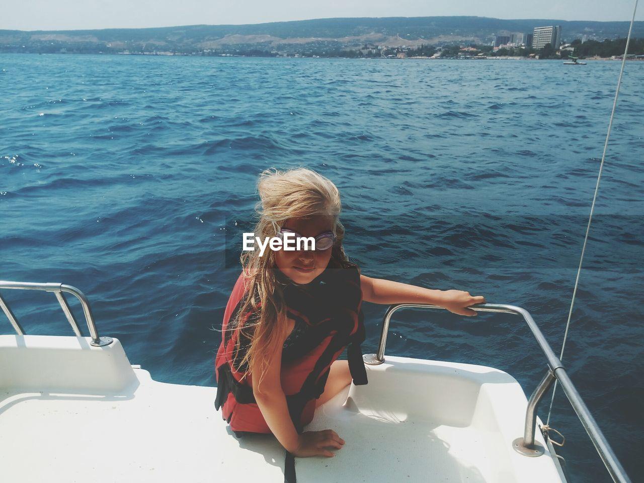 Girl Sitting On Yacht