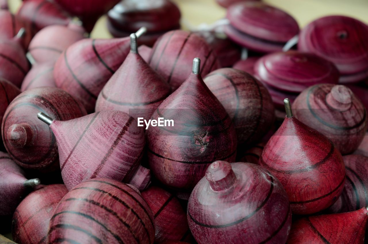 Close-up of wooden spinning tops in workshop