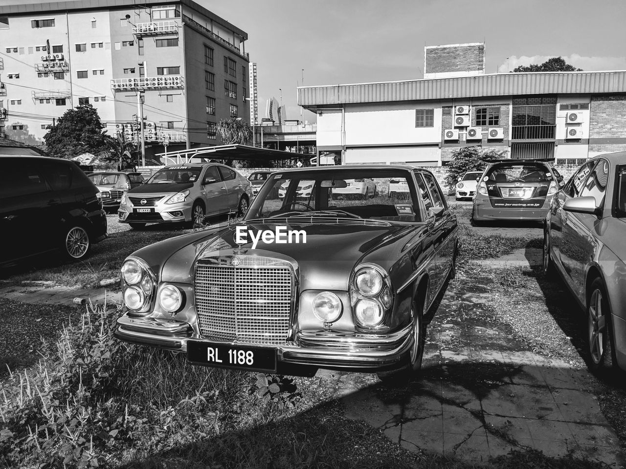 mode of transportation, building exterior, transportation, car, motor vehicle, land vehicle, built structure, architecture, city, retro styled, day, street, vintage car, building, sky, nature, no people, outdoors, ruined