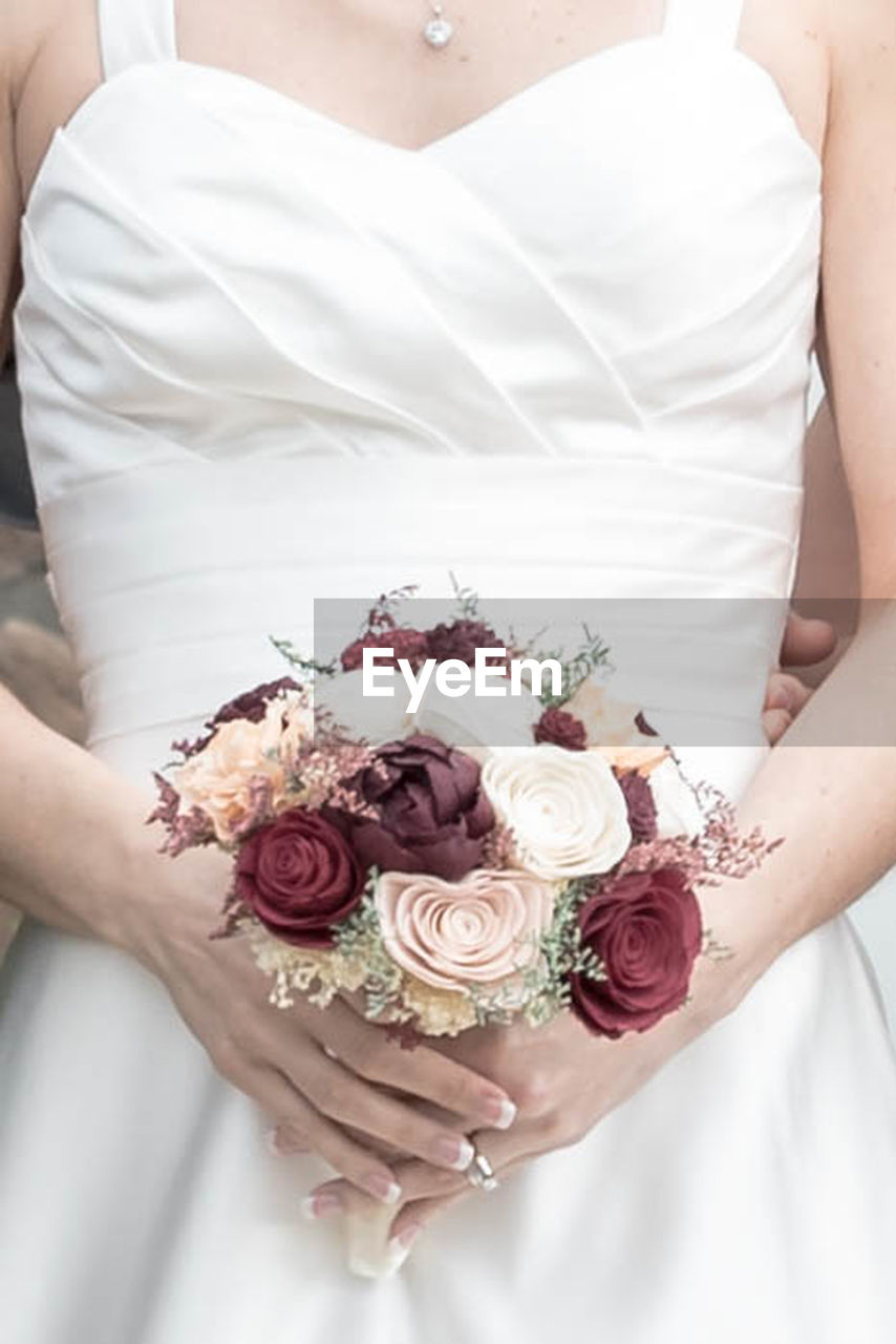 midsection, celebration, flowering plant, flower, holding, bouquet, flower arrangement, wedding, bride, plant, rose, wedding dress, event, rose - flower, life events, newlywed, one person, adult, hand, couple - relationship, wedding ceremony
