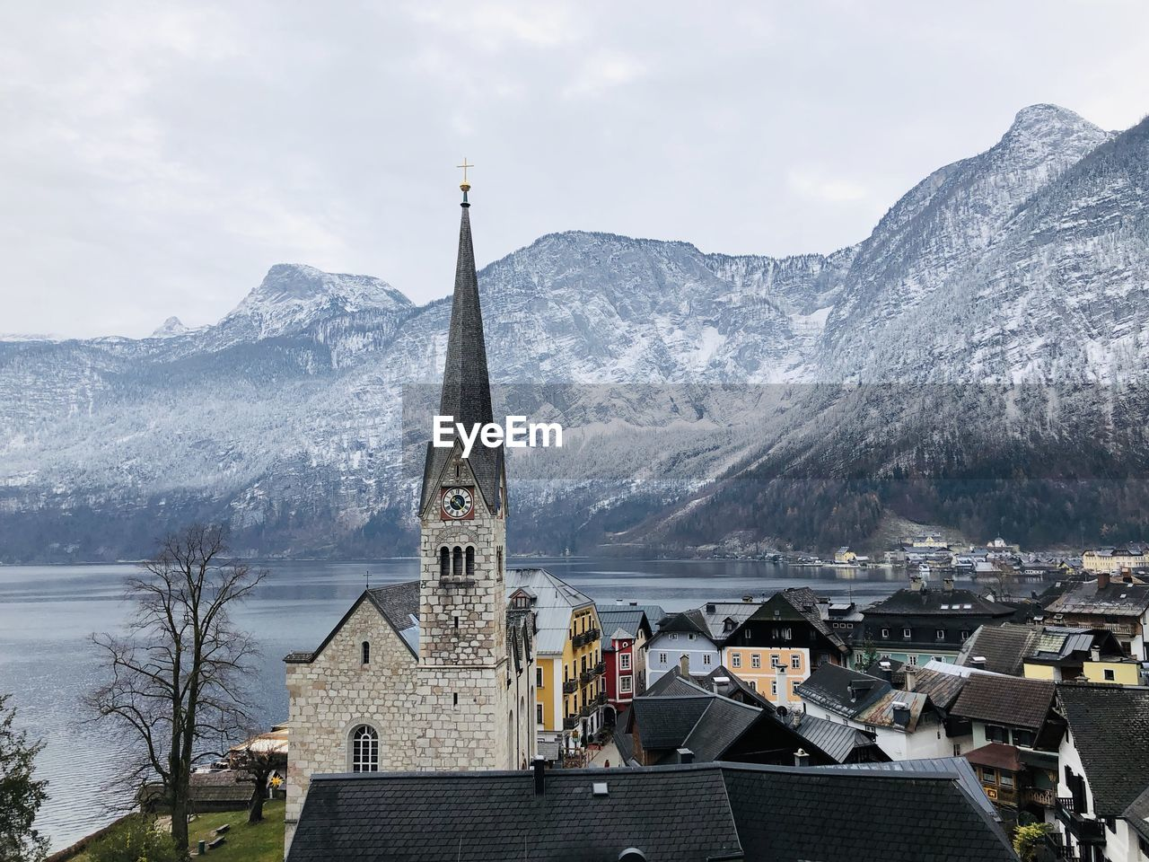 architecture, built structure, building exterior, building, place of worship, mountain, religion, belief, spirituality, sky, nature, mountain range, city, cold temperature, tower, winter, no people, outdoors, spire, snowcapped mountain