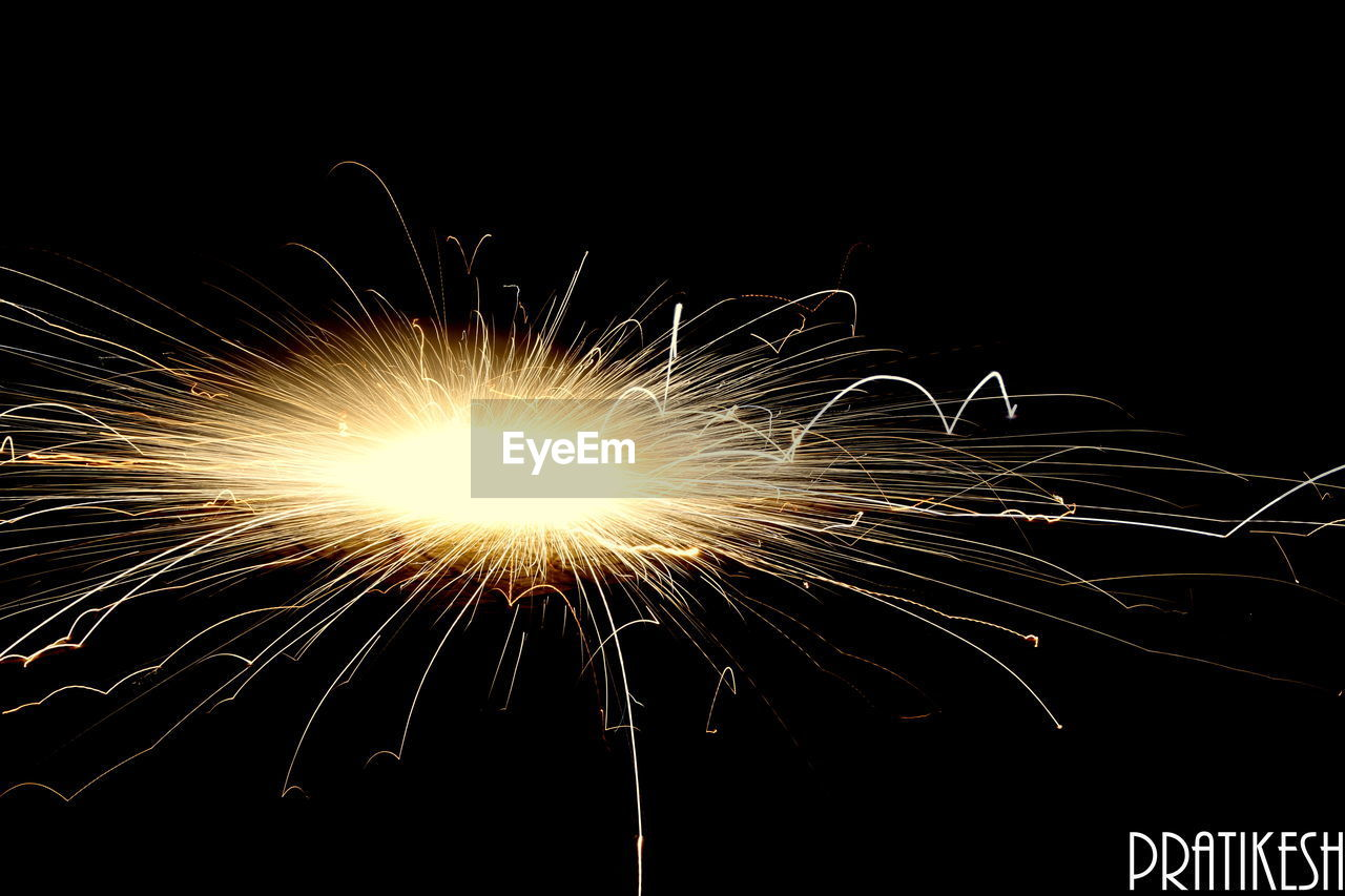 night, long exposure, sparks, firework - man made object, exploding, motion, firework display, celebration, no people, burning, arts culture and entertainment, illuminated, wire wool, sparkler, outdoors, close-up, sky