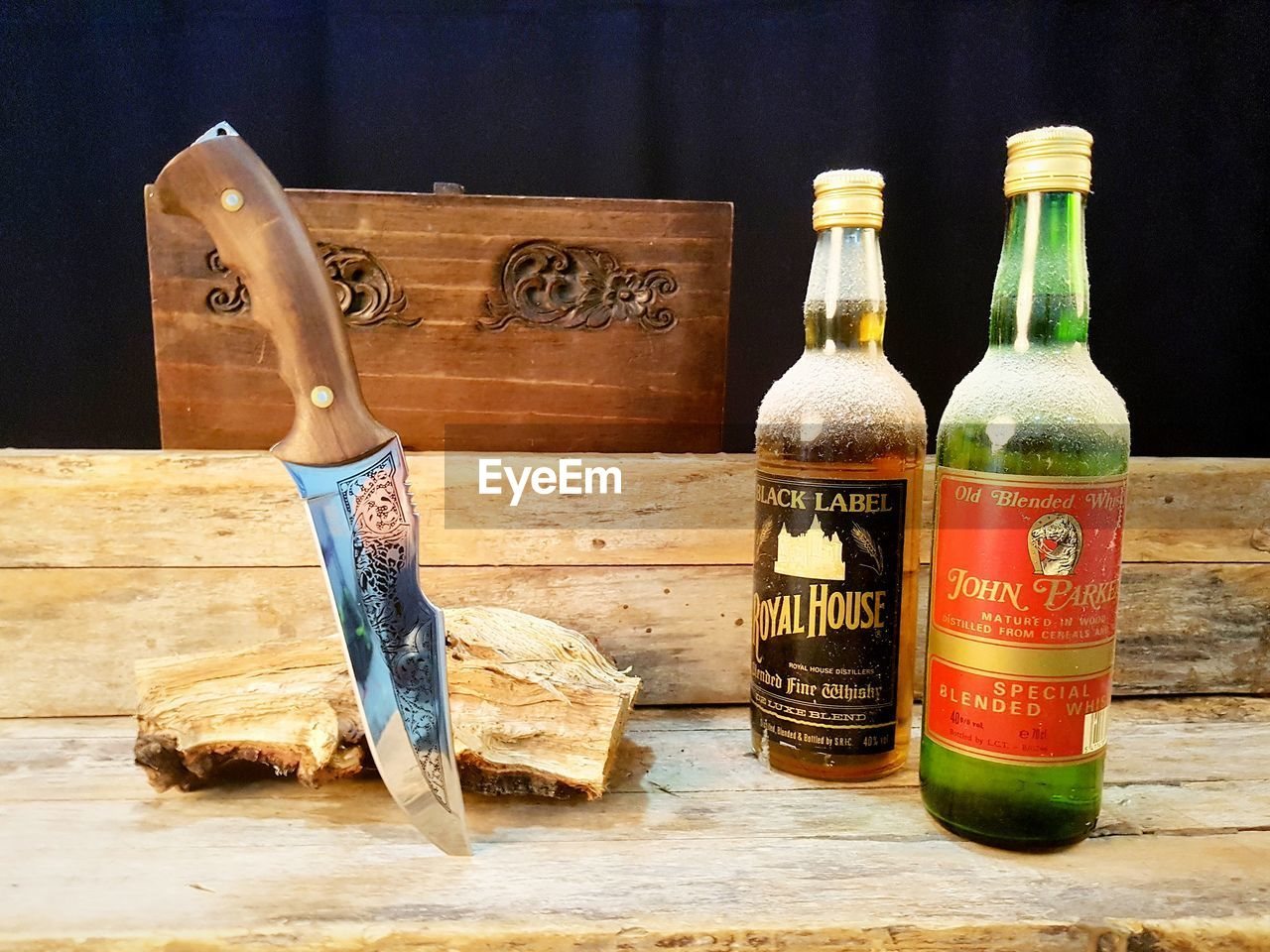 still life, container, table, wood - material, bottle, indoors, text, no people, communication, variation, choice, close-up, food and drink, western script, cutting board, glass - material, art and craft, nature, antique, group of objects