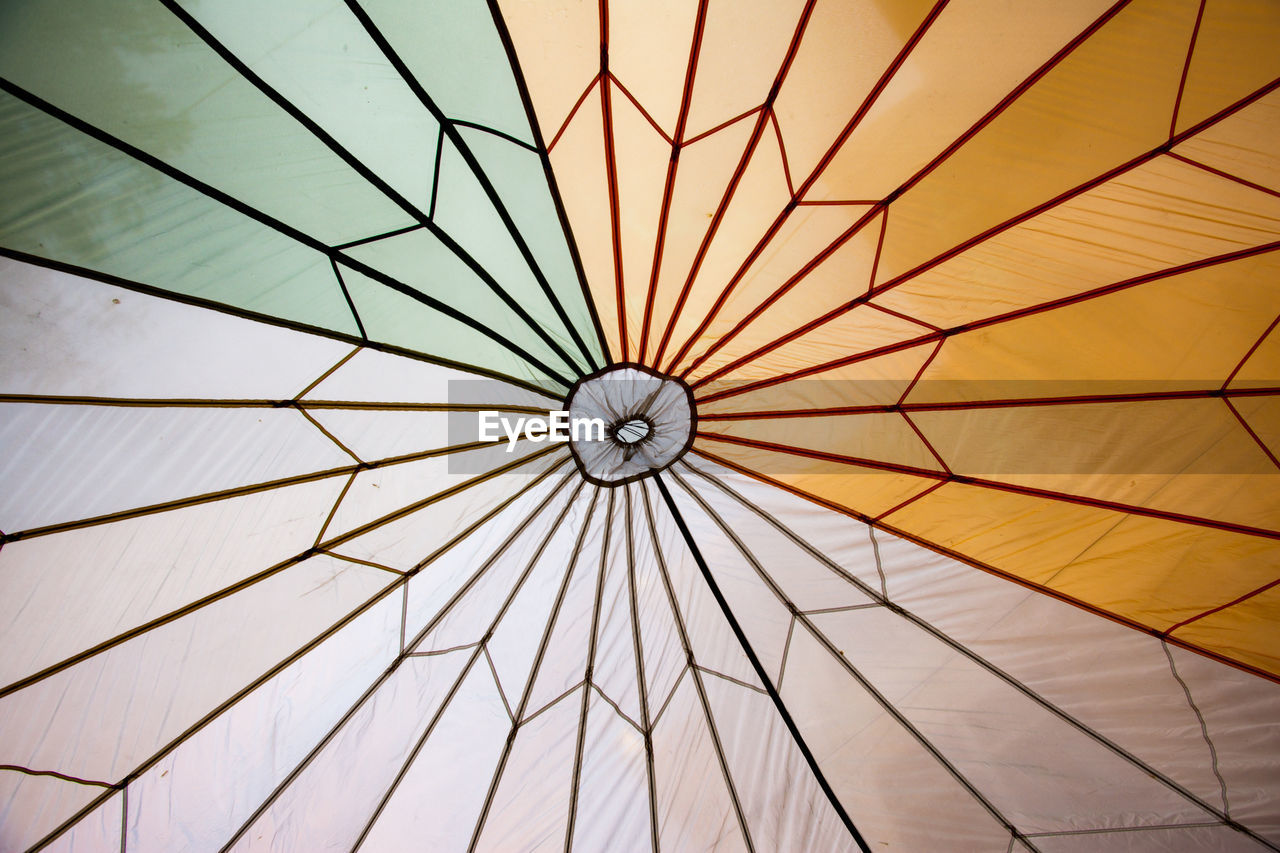 pattern, indoors, ceiling, architecture, low angle view, no people, full frame, built structure, backgrounds, dome, design, shape, geometric shape, day, sunlight, directly below, yellow, close-up, nature, cupola, luxury, concentric