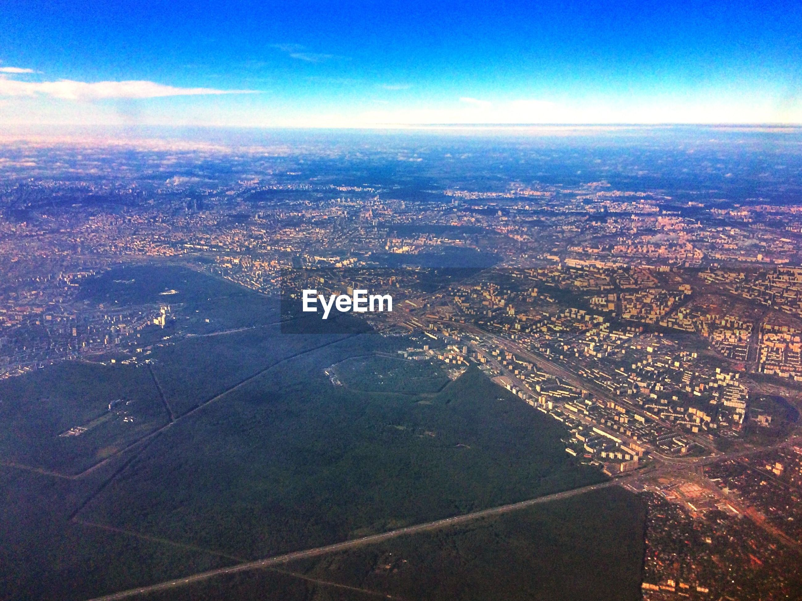 AERIAL VIEW OF LANDSCAPE AGAINST SKY IN CITY